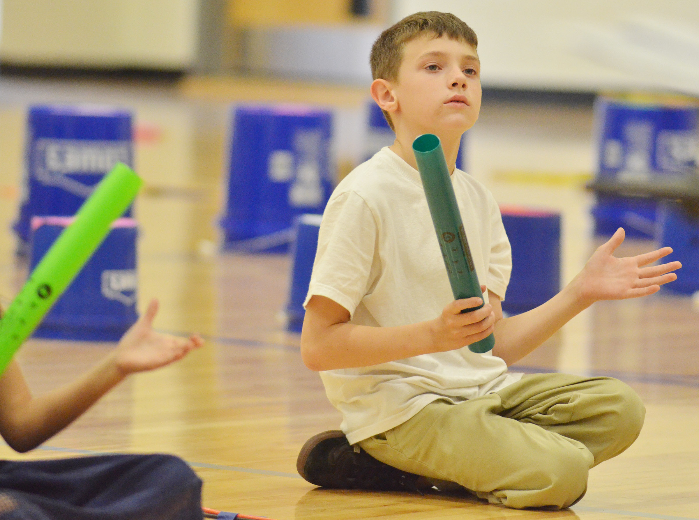 CES second-grader Aidan Wilson plays the boomwhacker.