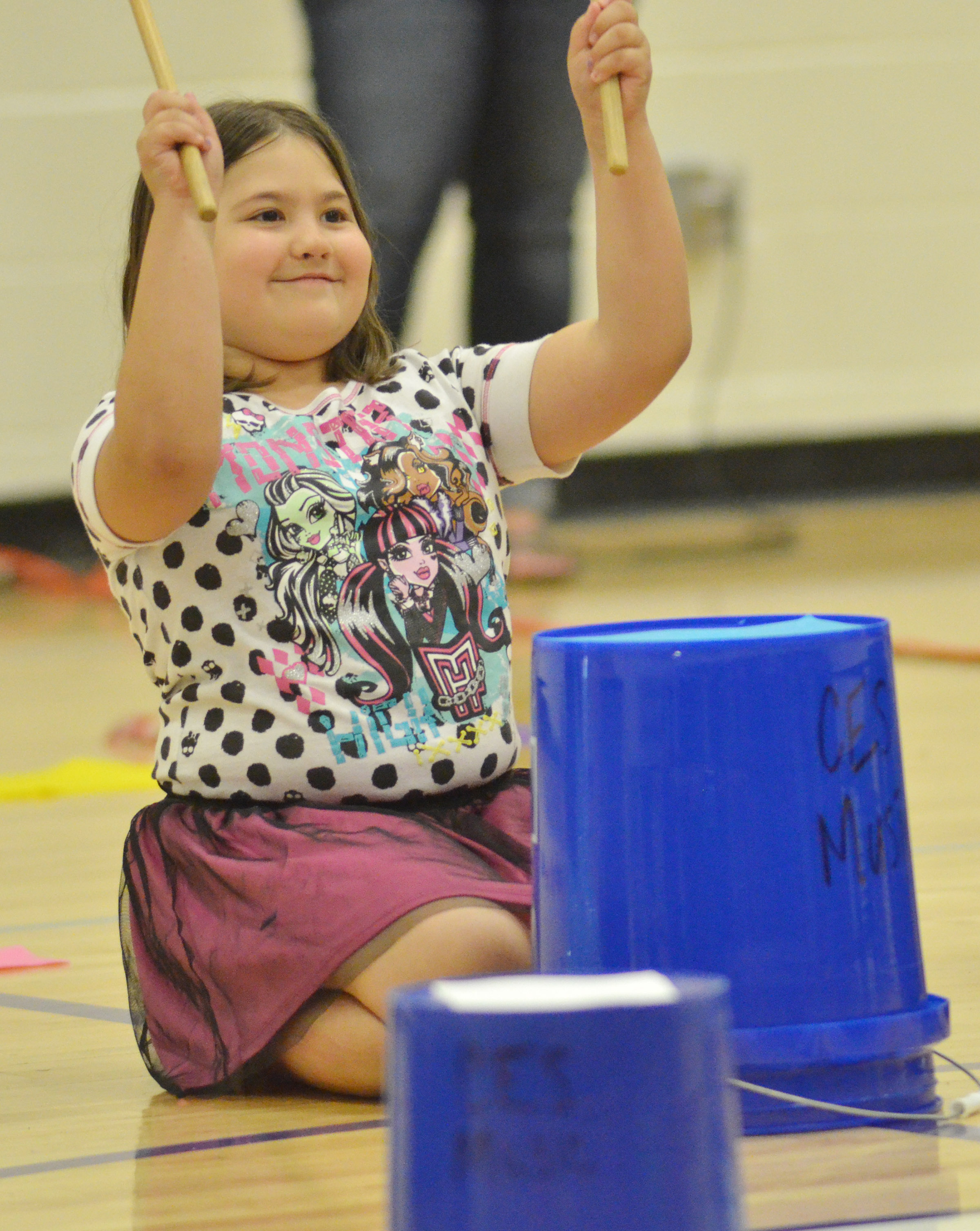 CES second-grader Marissa Sumners keeps the rhythm with her drum sticks.