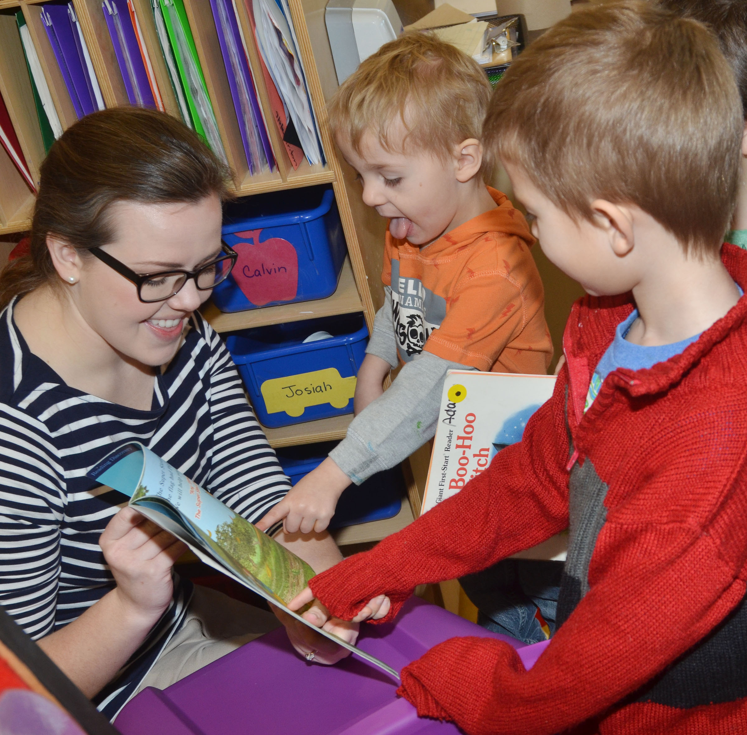 Campbellsville University education student Amanda Hamilton reads with CES preschool students Chase Russell, at left, and Andrew Stout.