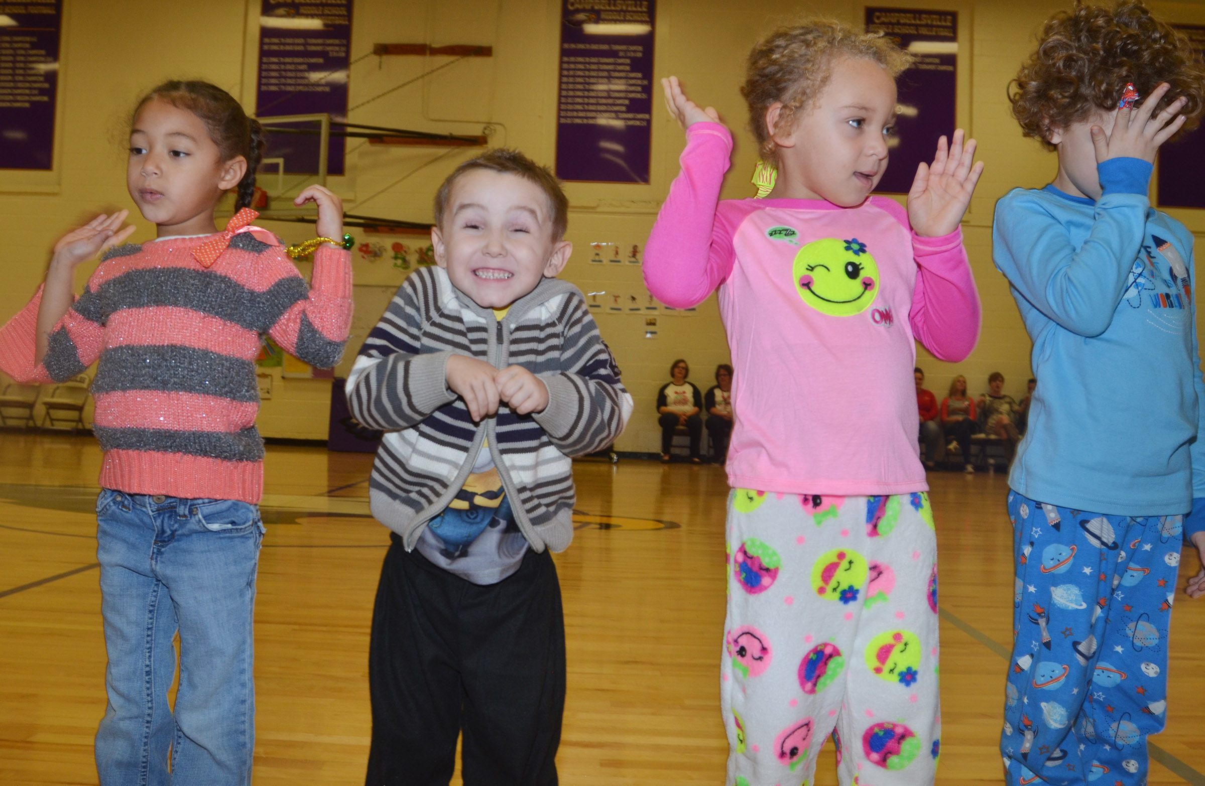 CES preschool students, from left, Onyx Hunter, Noelan McMahan, Jayla Barbee and Zyron Young perform with their classmates.