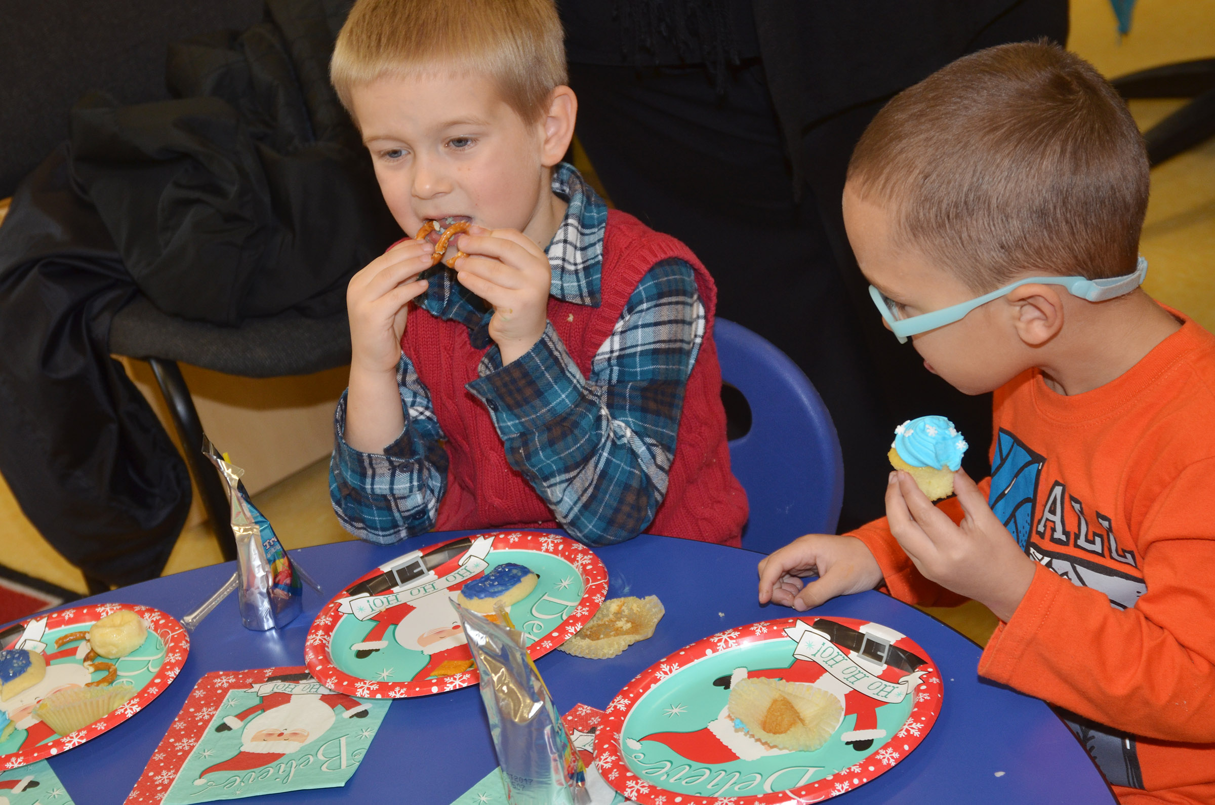 CES preschool students Jacob Parrish, at left, and Chanler Mann enjoy their snacks.