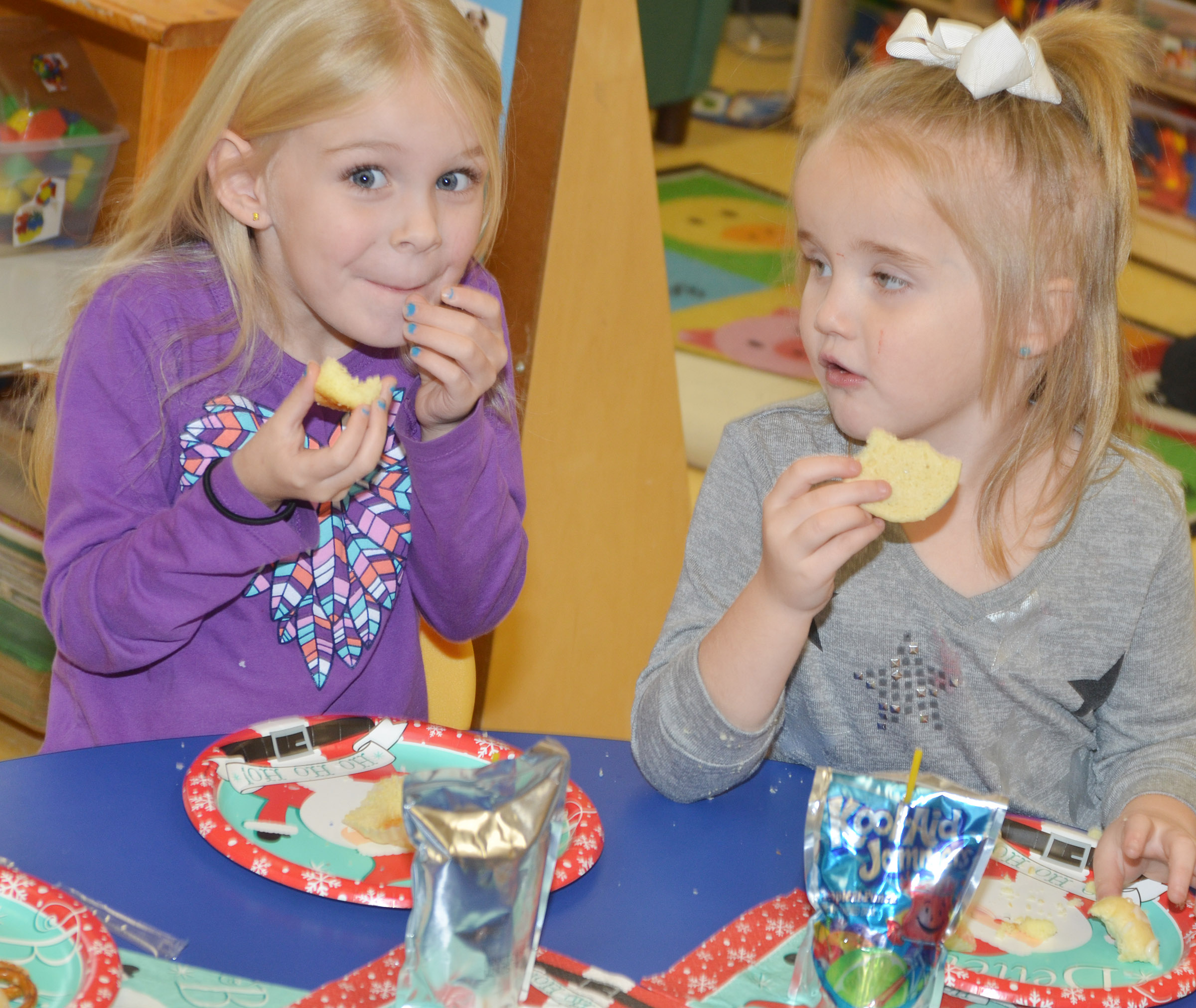 CES preschool students Alinna Bray, at left, and Trinity Dye enjoy their special treats.