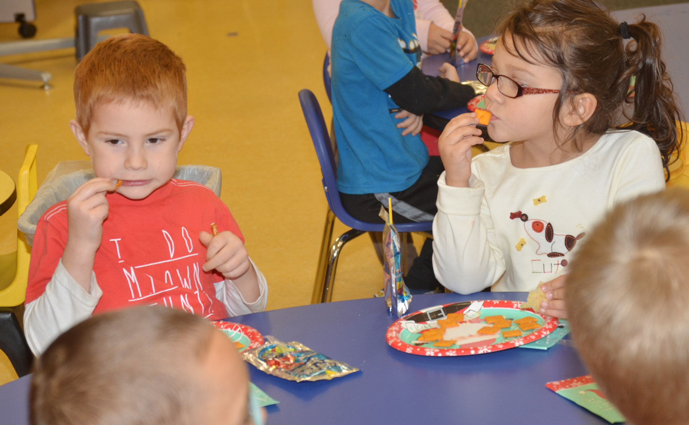 CES preschool students Kennon Dotson, at left, and Rylee Karr enjoy their snacks.