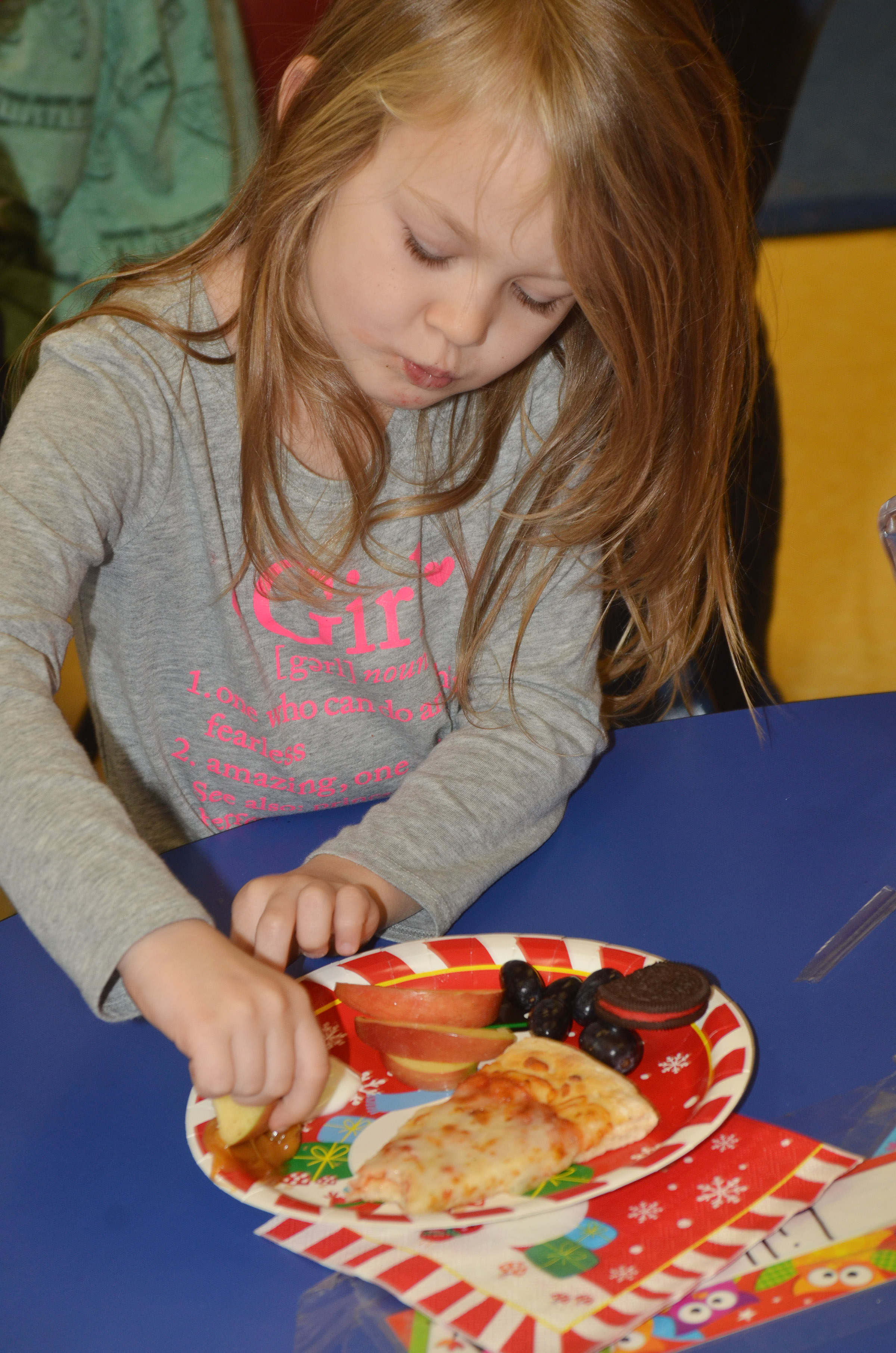 CES preschool student Lilly Spencer enjoys her snacks.