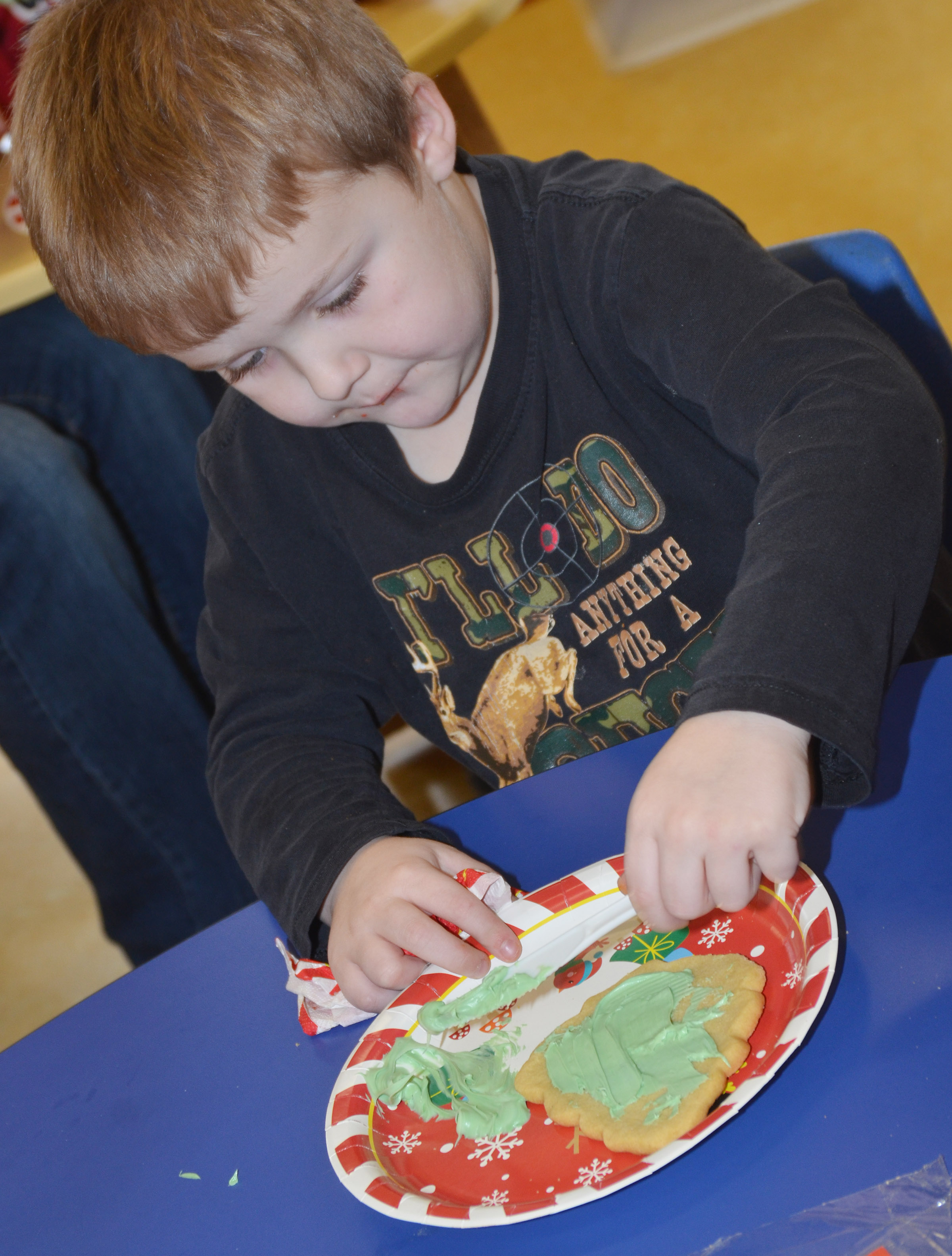 CES preschool student Levi Dye decorates his cookie.