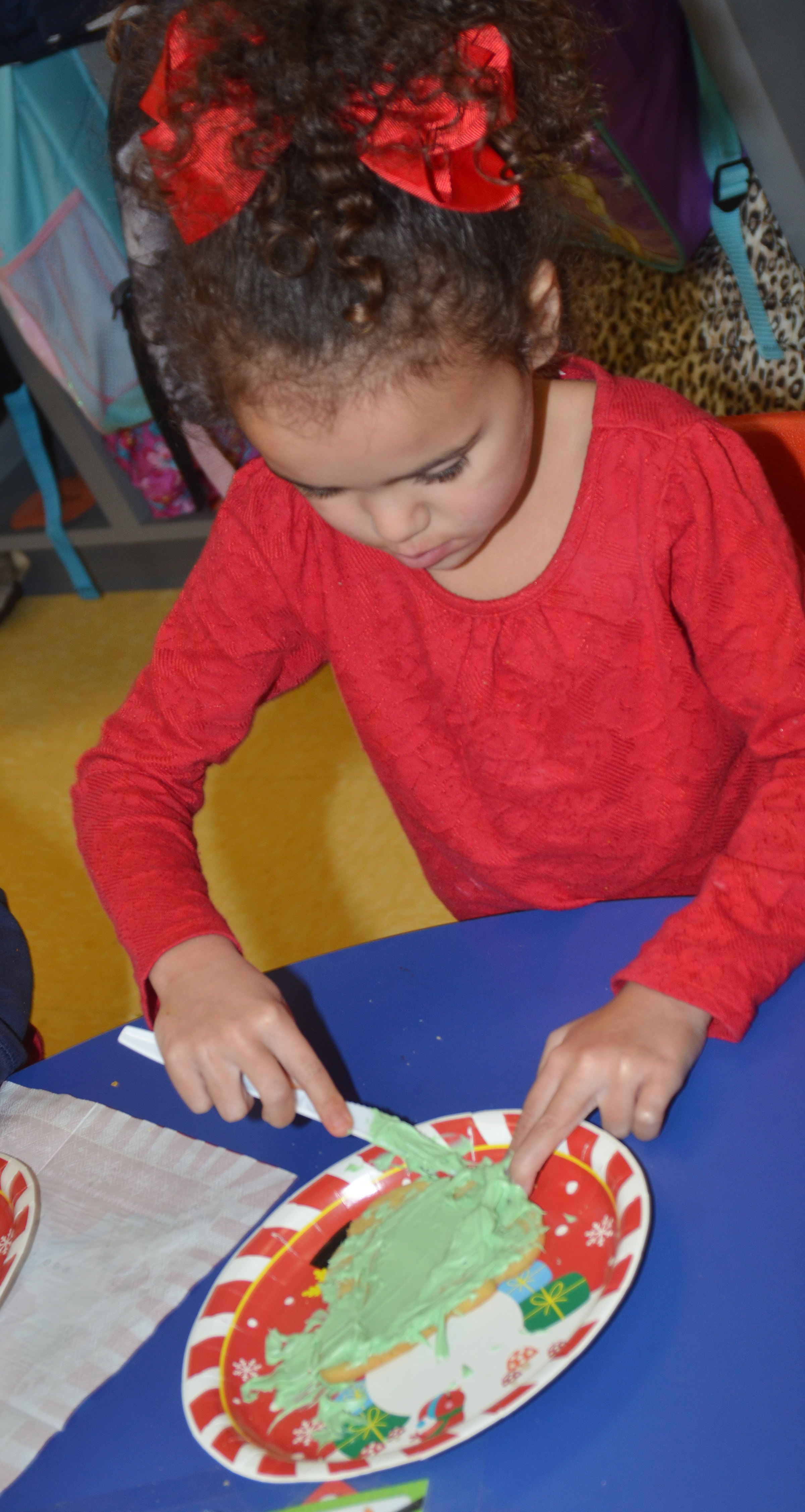 CES preschool student Adelyn Litsey decorates her cookie.