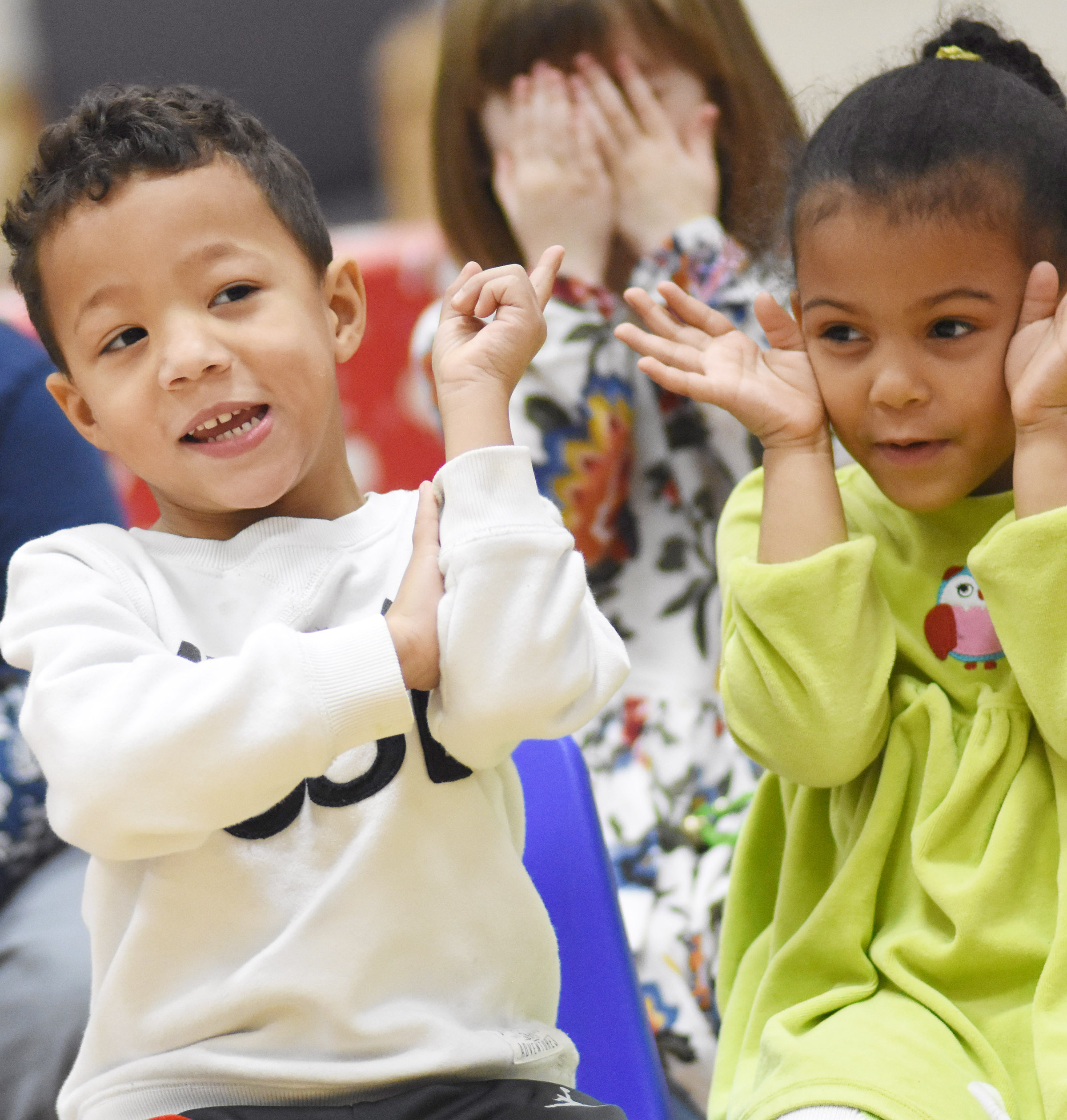 CES preschool students Ace Turner, at left, and Ziah Boggs sing and dance.