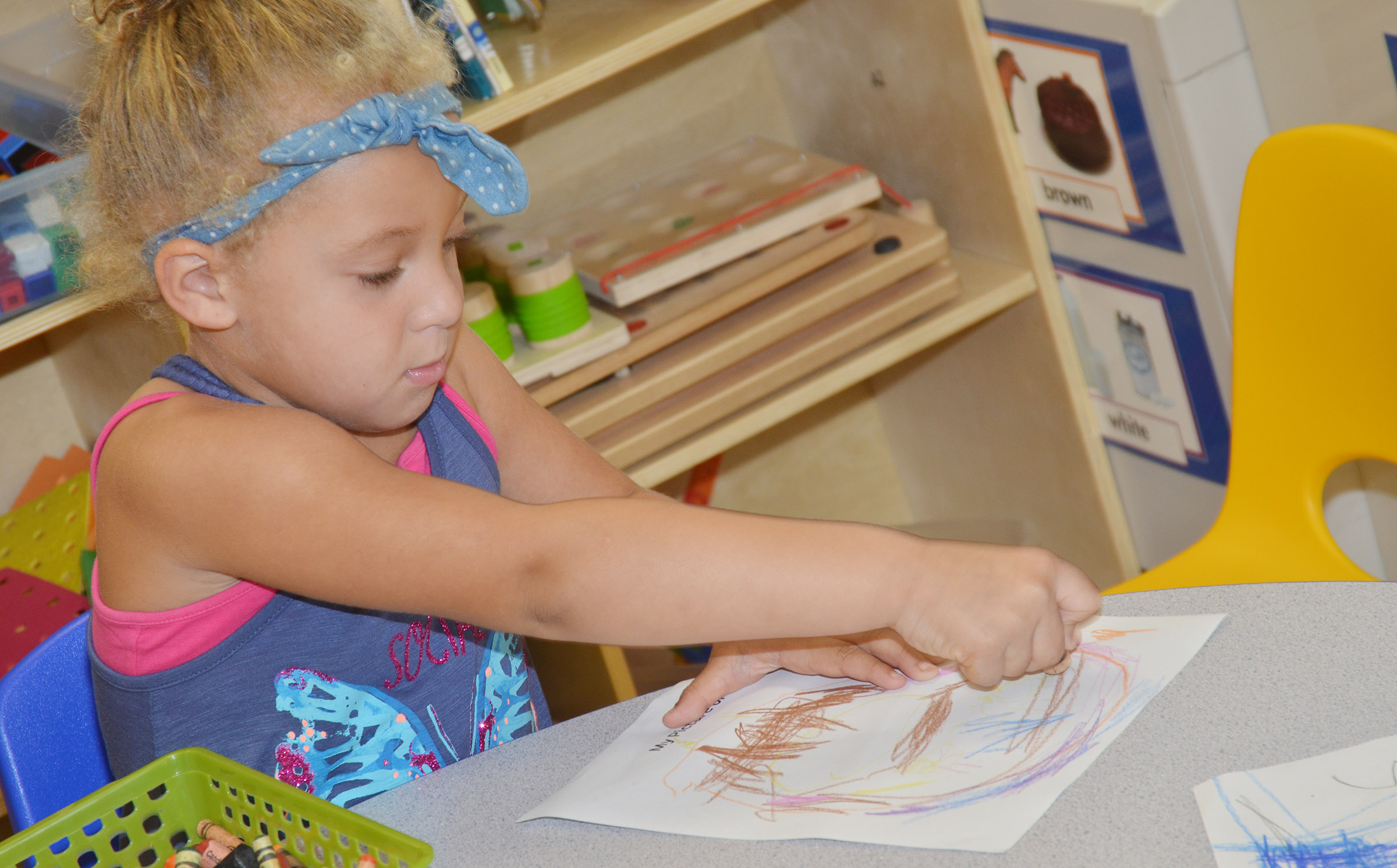 CES preschool student Jayla Barbee draws her self-portrait.
