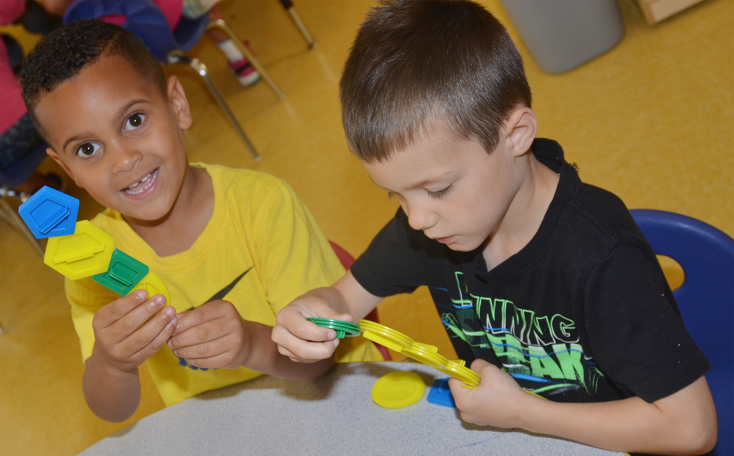 CES preschool students Kingston Cowherd, at left, and Levi Ritchie build together.