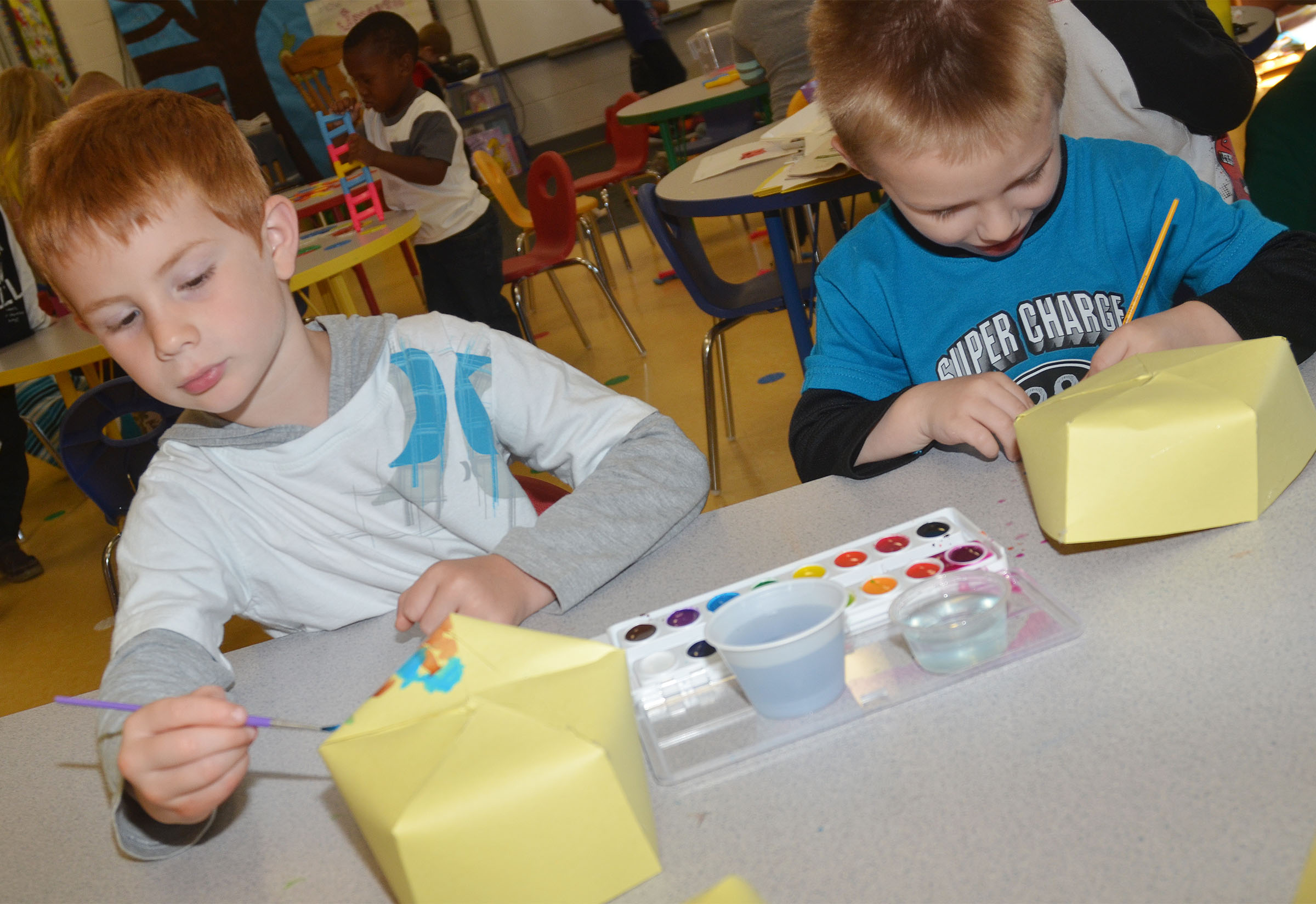 CES preschool students Kennon Dotson, at left, and Nevon Stum paint their Derby hats.
