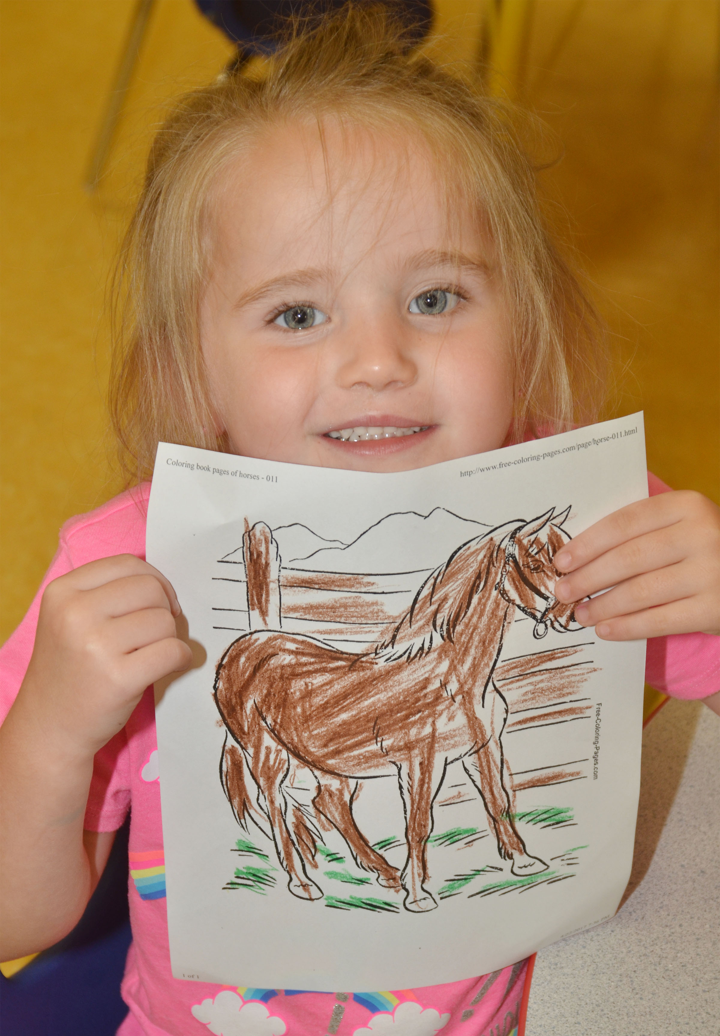 CES preschool student Trinity Dye holds a horse picture she colored.