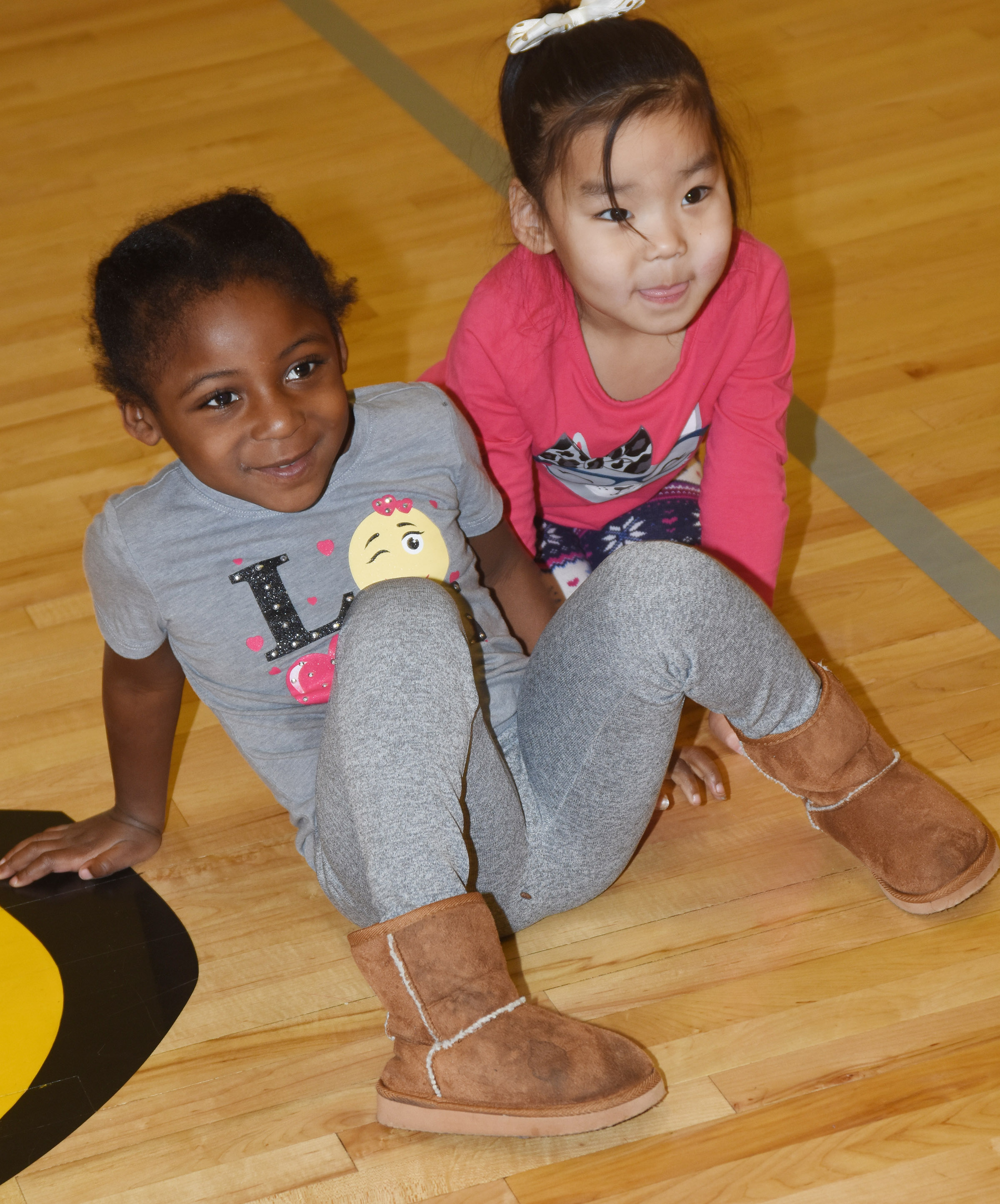 CES preschool students Harmony Brown, at left, and Marla Bat have fun together.
