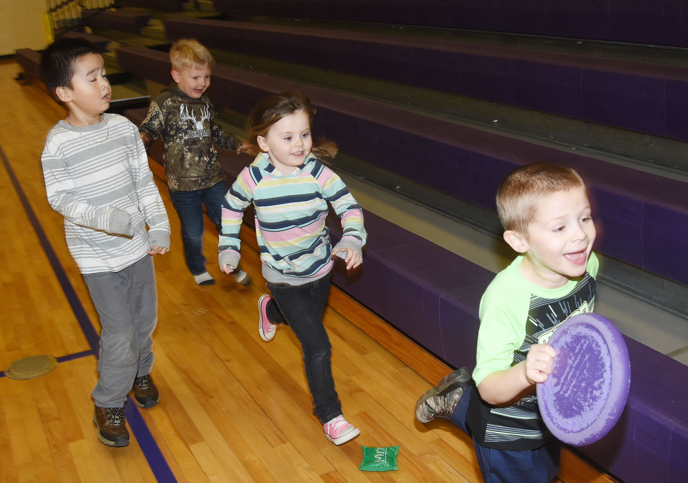 From left, CES preschool students Minh Turdo, Hoyt Davis, Tori Clark and Brian Daniels run together in the gym.