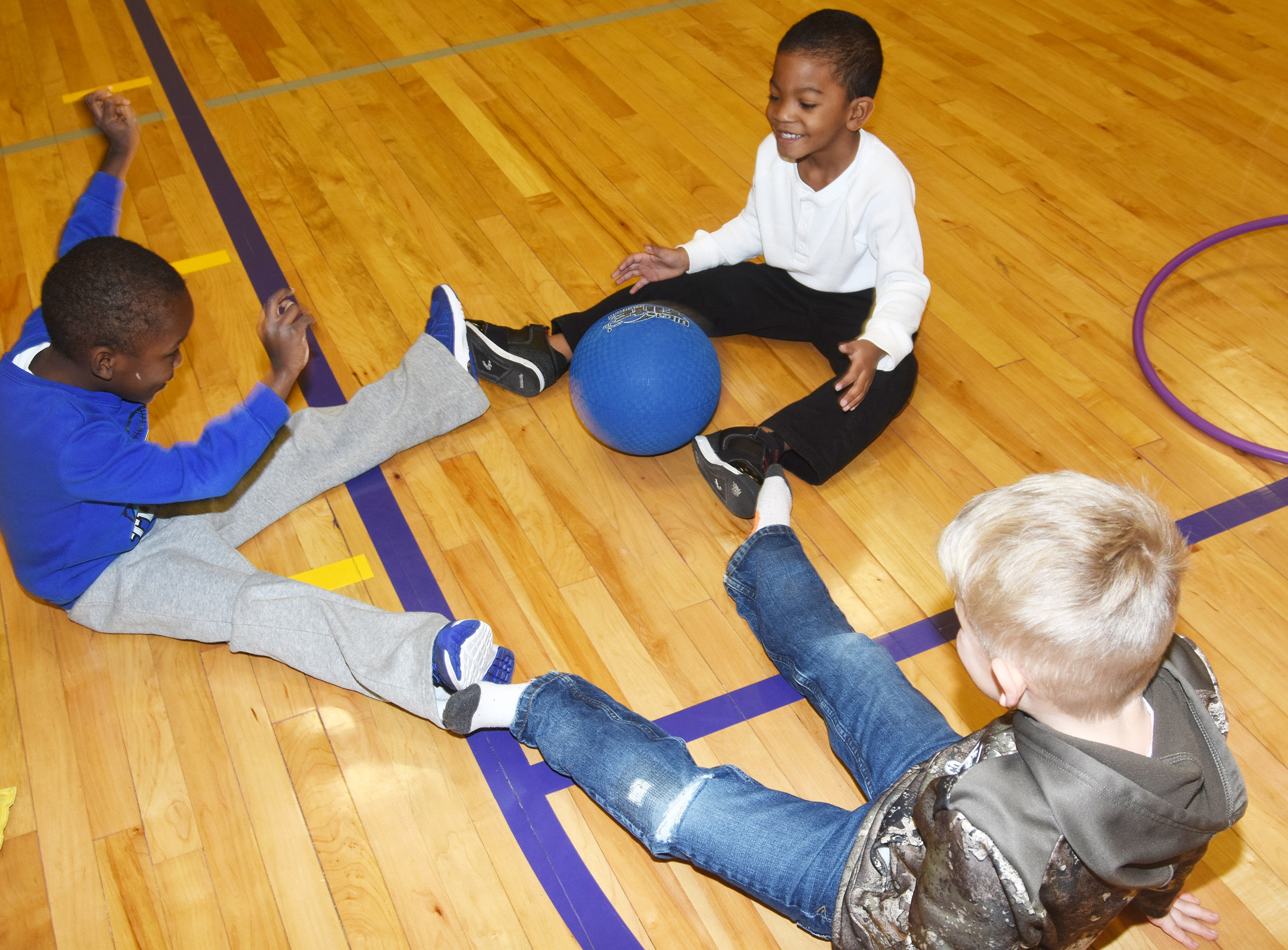 From left, CES preschool students Xavien Smith, Rakim Dunn and Hoyt Davis have fun together playing with a kickball.