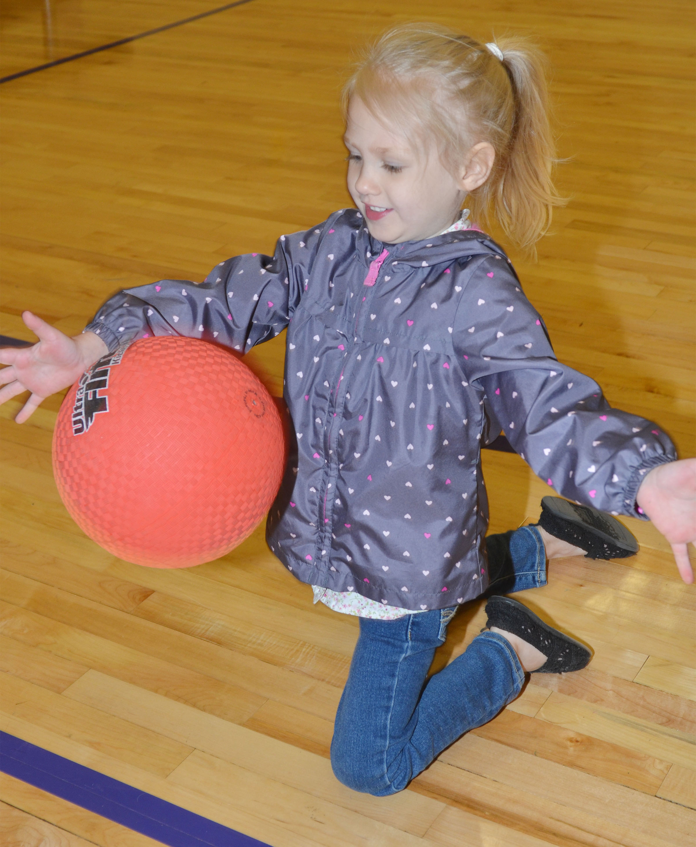 CES preschool student Trinity Lewis plays with a ball.