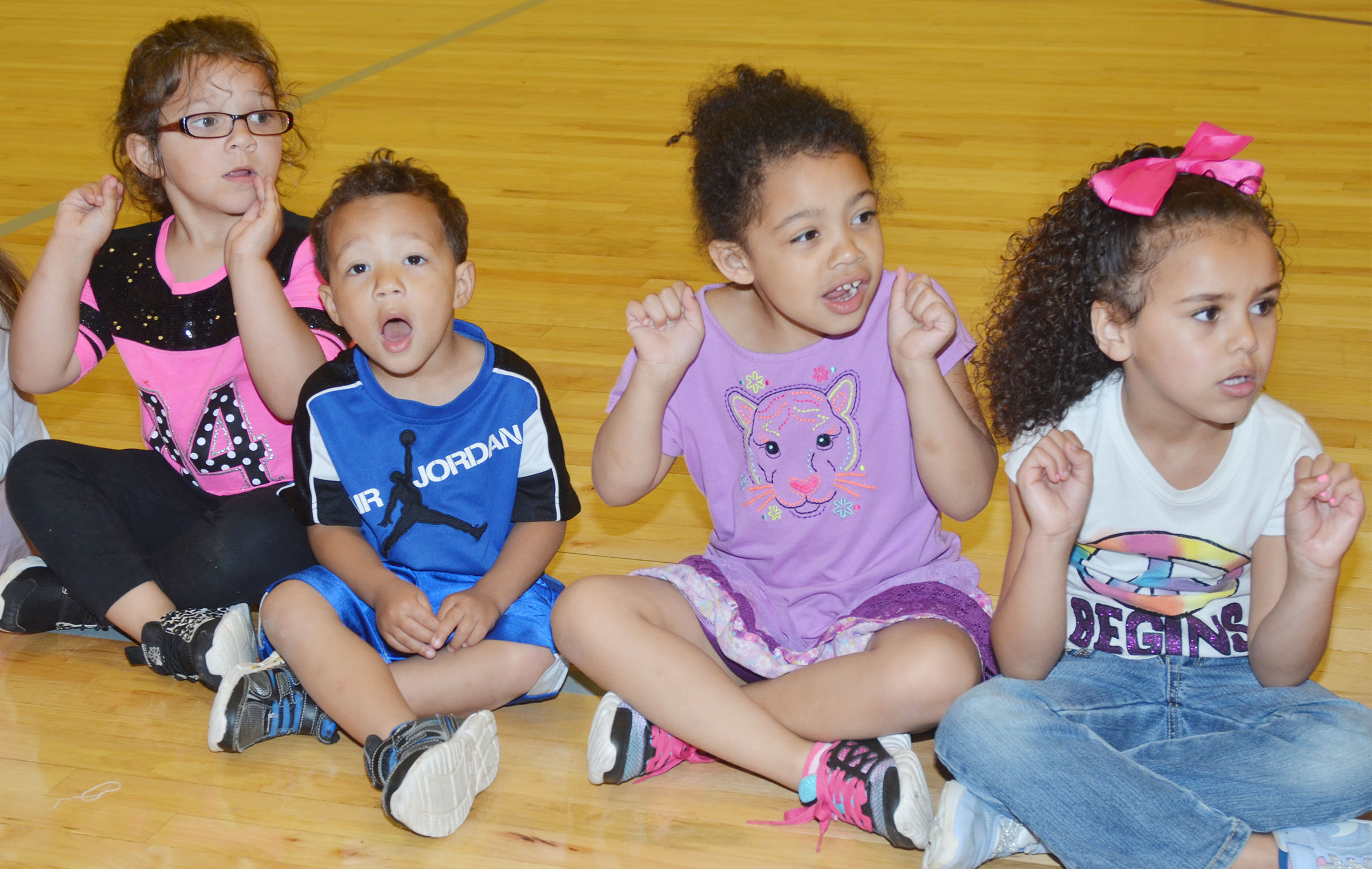 From left, CES preschool students Addisyn Taylor, Ace Turner, Rylee Karr and Adelyn Litsey sing together.