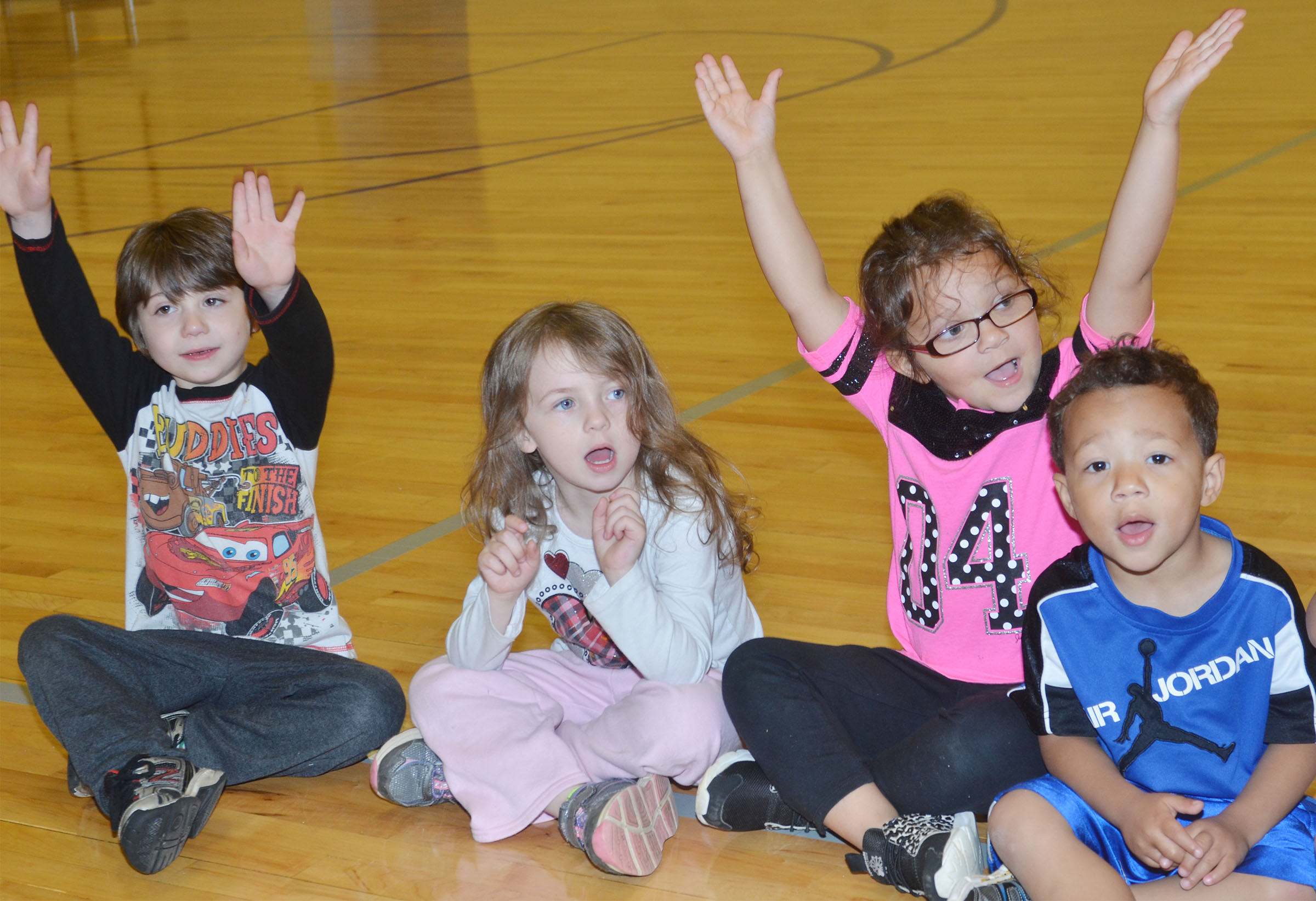CES preschool students, from left, Josiah Dean, Dahlia Ward, Addisyn Taylor and Ace Turner sing.