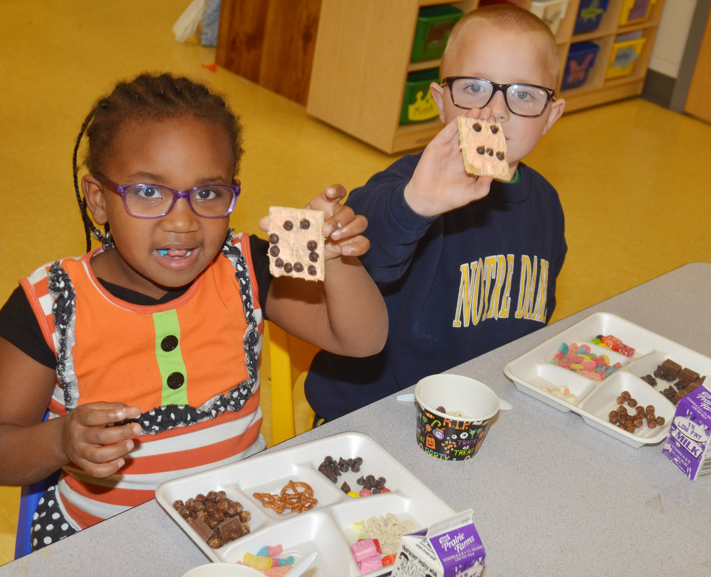 CES preschool students Kyona Mitchell and Anthony McClure hold their monster cookies.