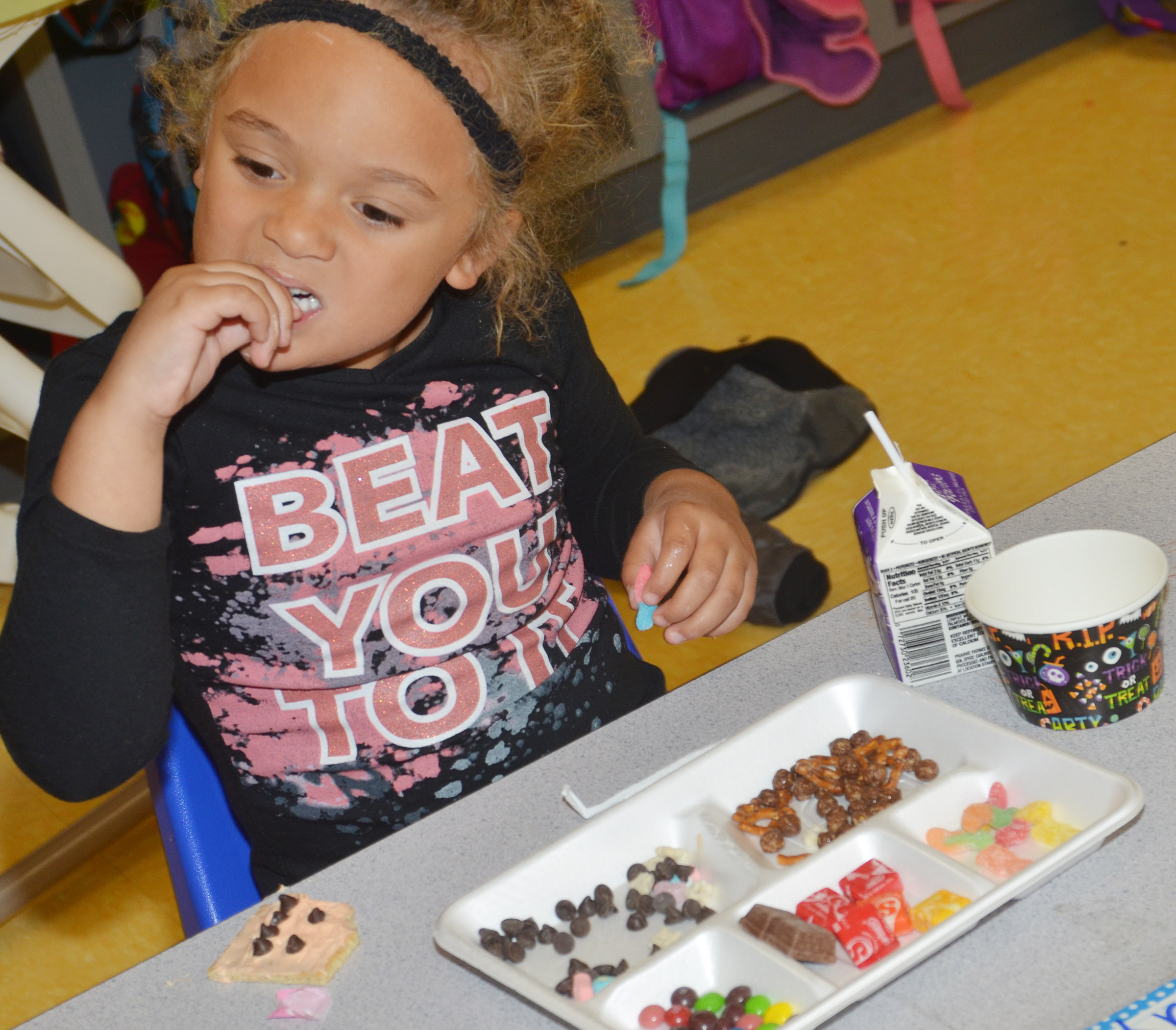 CES preschool student Layla Barbee enjoys her candy.