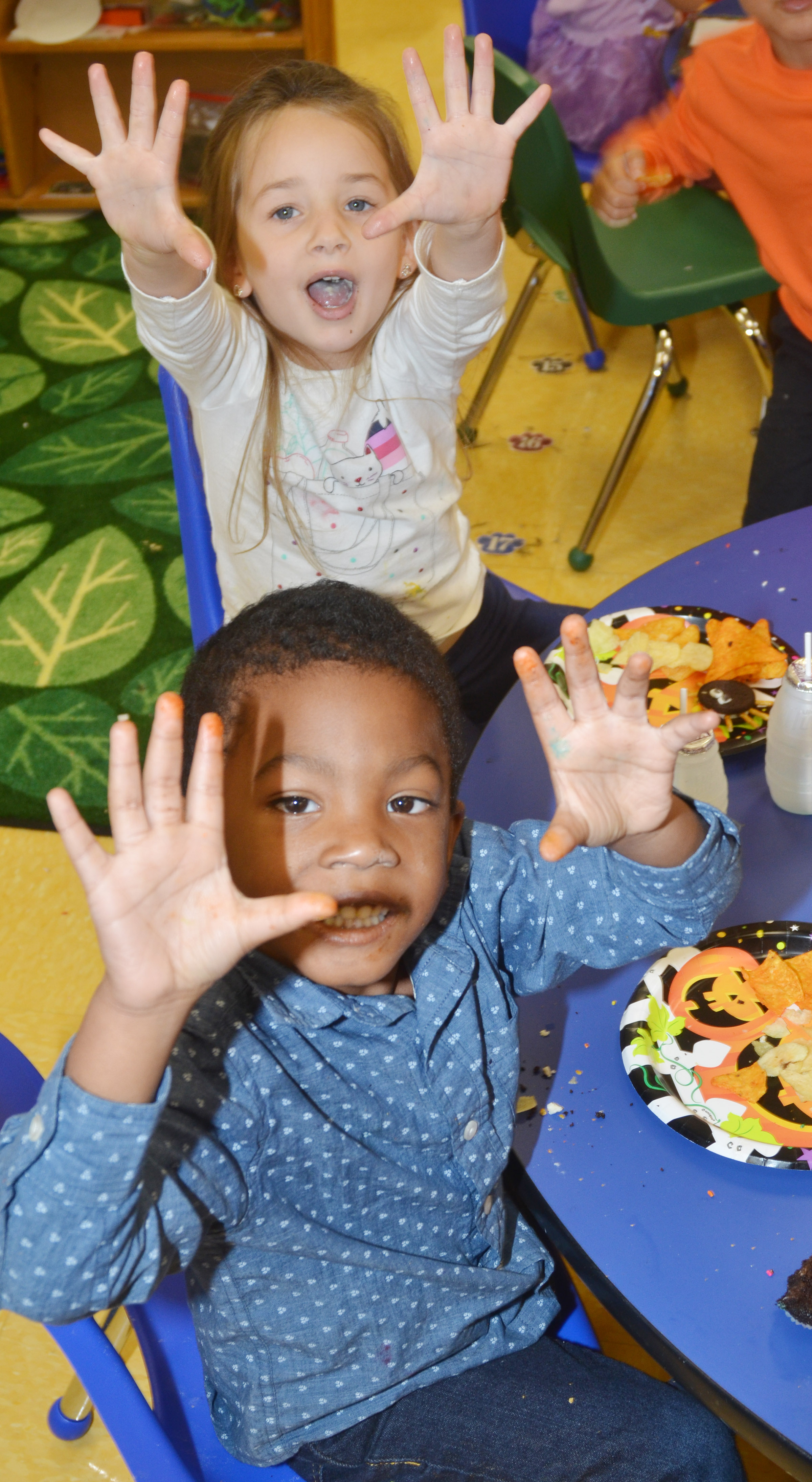 CES preschool students Rakim Dunn and Lylah Davis try to scare their classmates at their Halloween party.