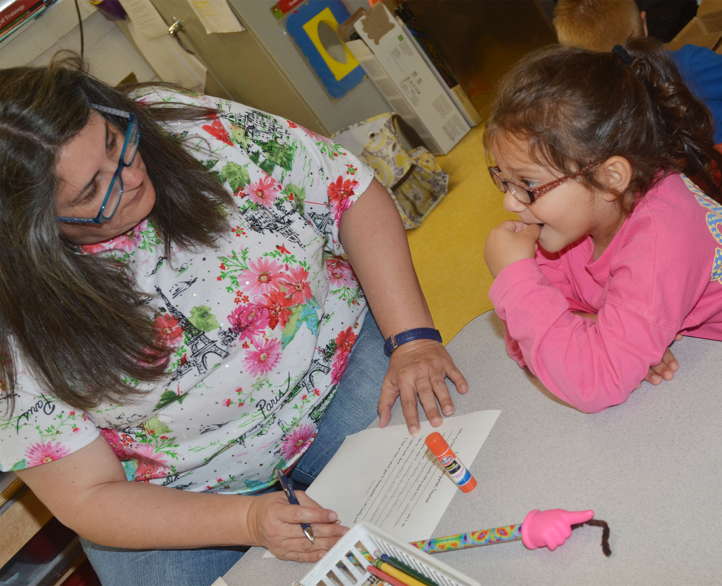 CES preschool student Addisyn Taylor answers questions with teacher Sherry Cowherd as they write Taylor's letter to her kindergarten teacher.