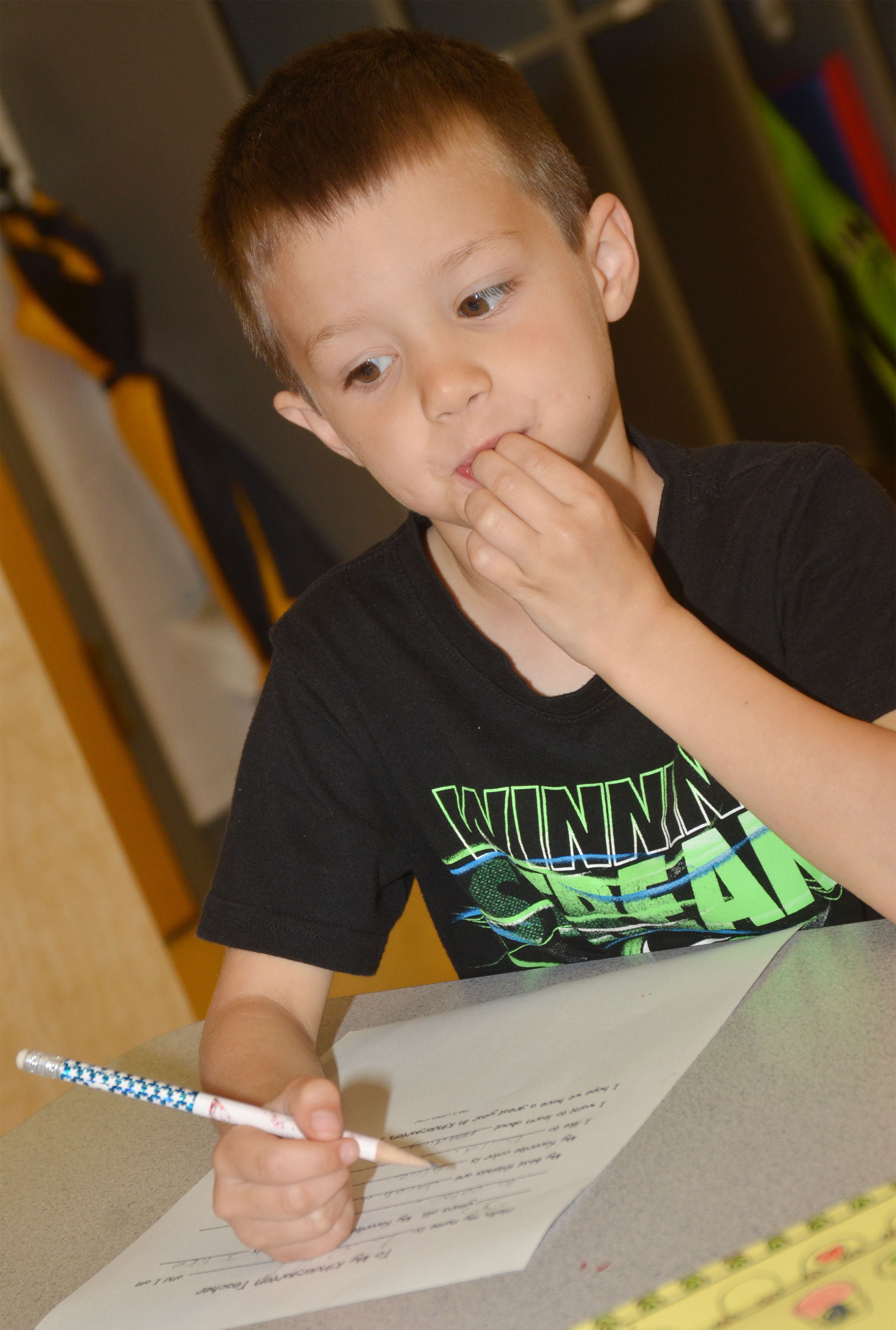 CES preschool student Levi Ritchie thinks about his answers for his letter to his kindergarten teacher.