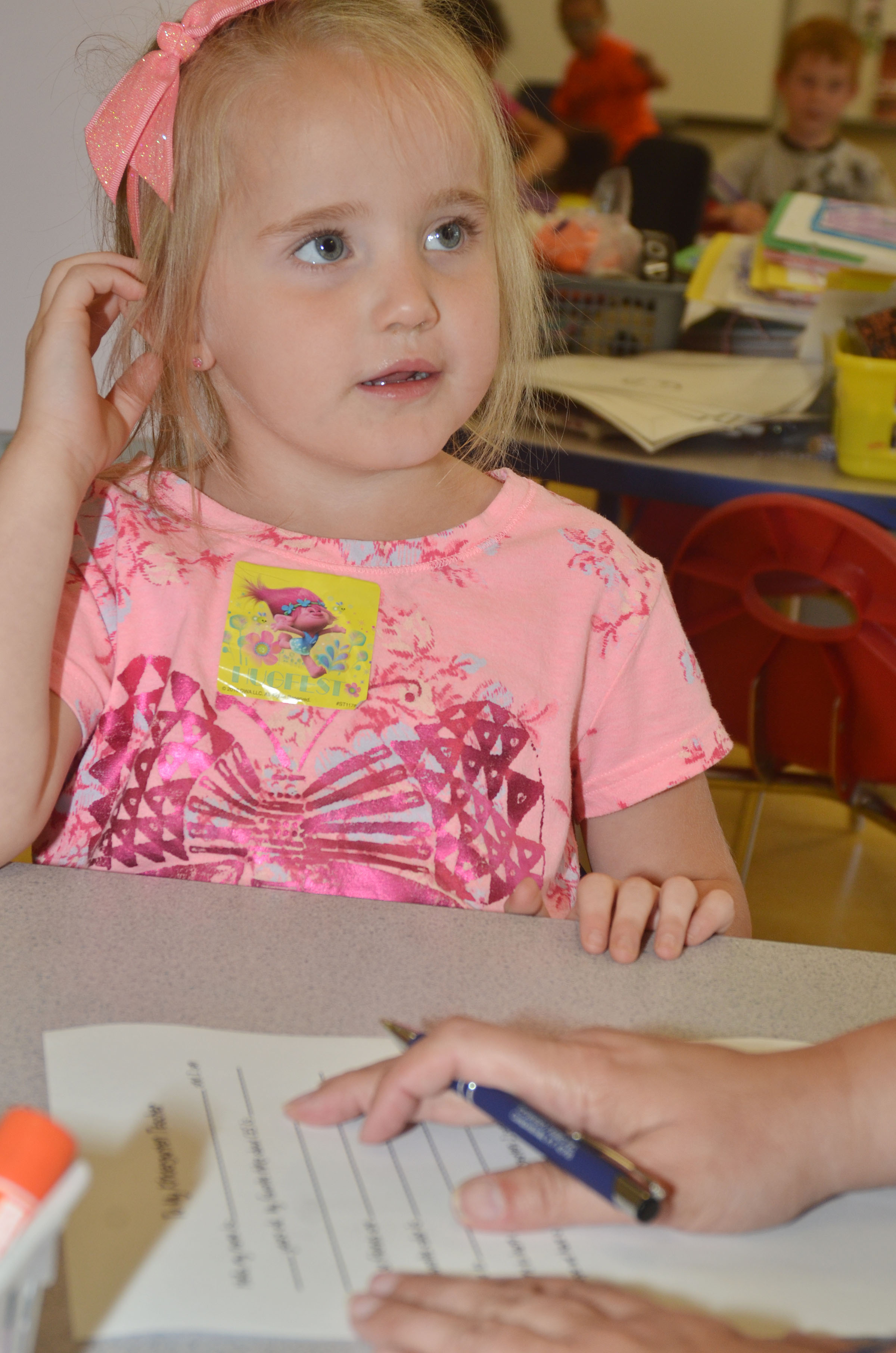 CES preschool student Trinity Dye answers questions for her letter to her kindergarten teacher.