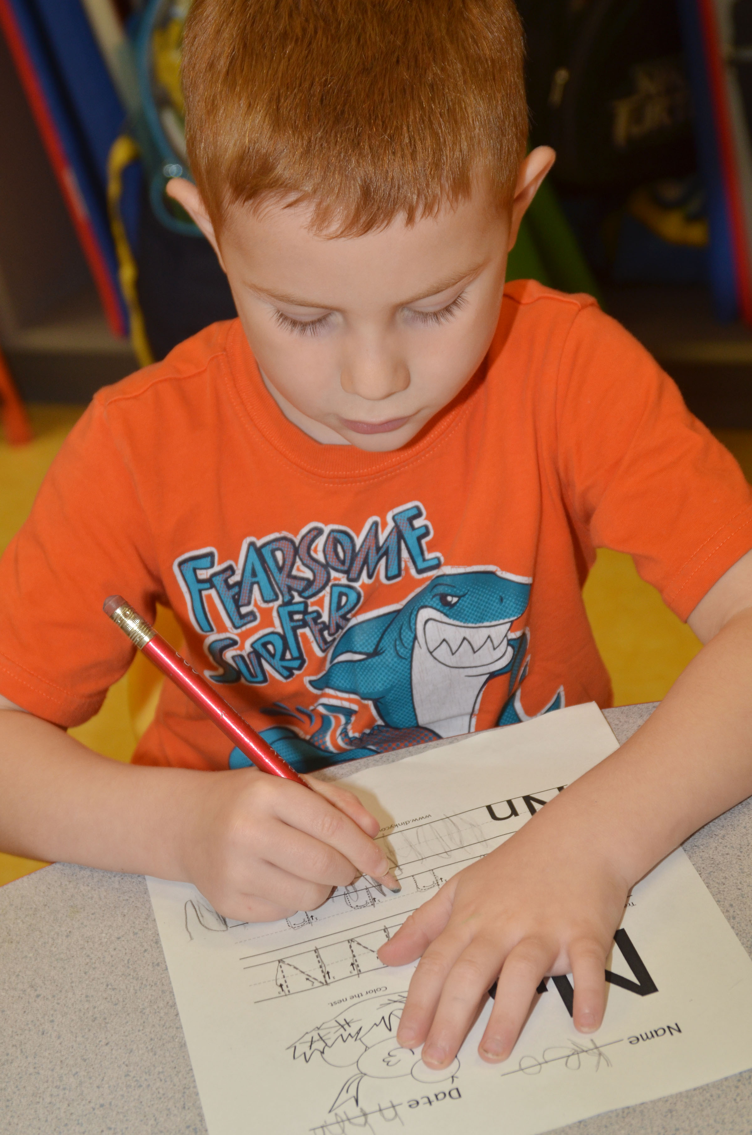 CES preschool student Kennon Dotson writes the letter N.