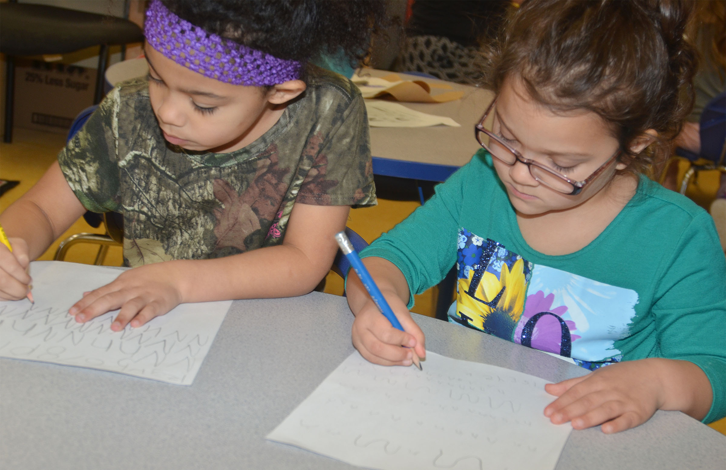 CES preschool students Rylee Karr, at left, and Addisyn Taylor write the letter N.