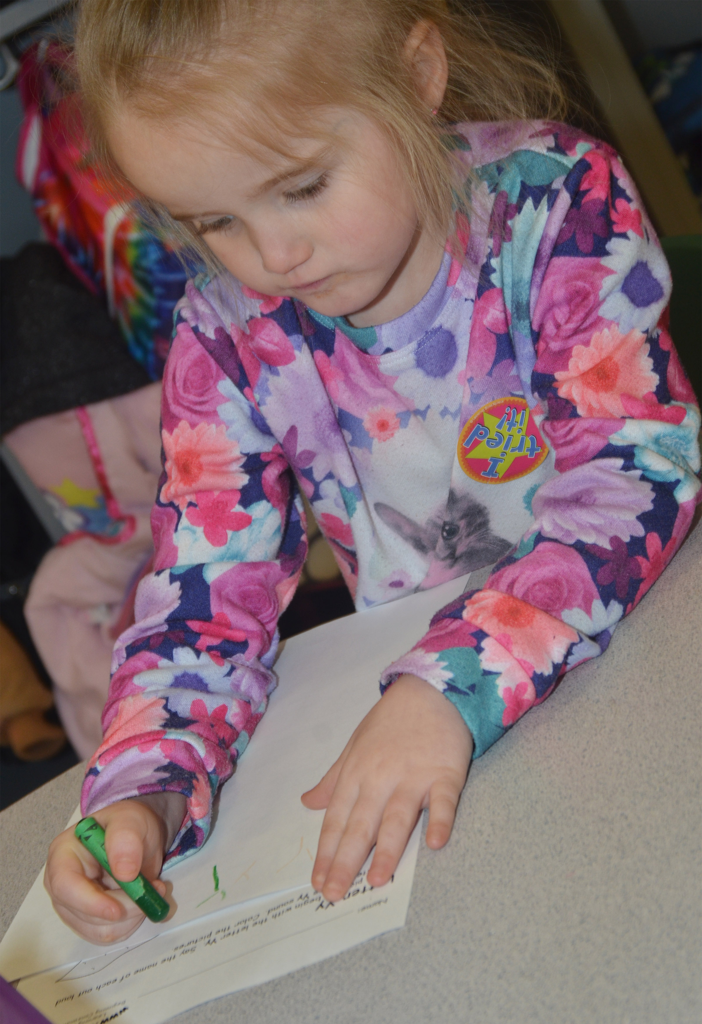 CES preschool student Trinity Dye writes the letter Y.