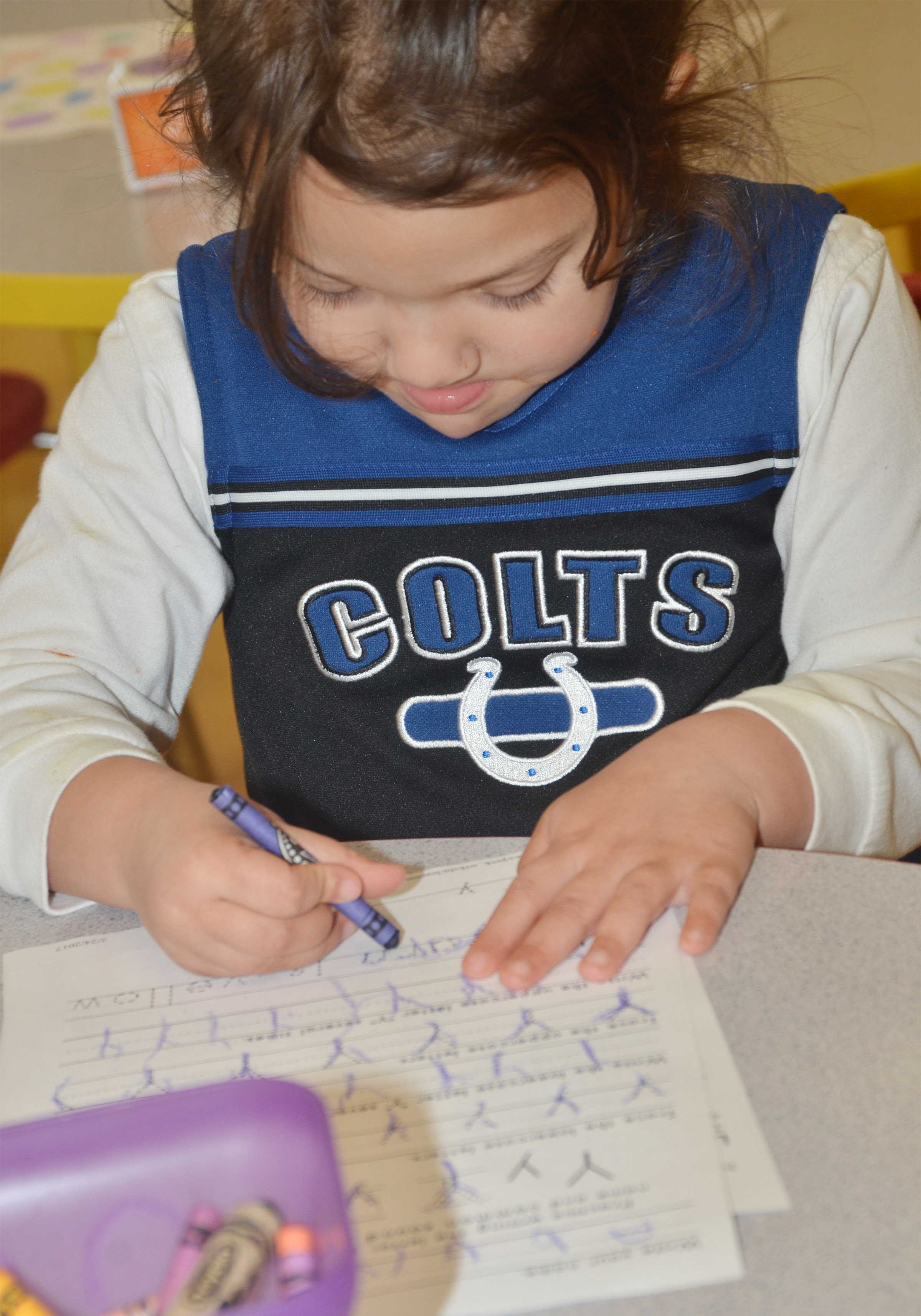 CES preschool student Addisyn Taylor practices writing the letter Y.