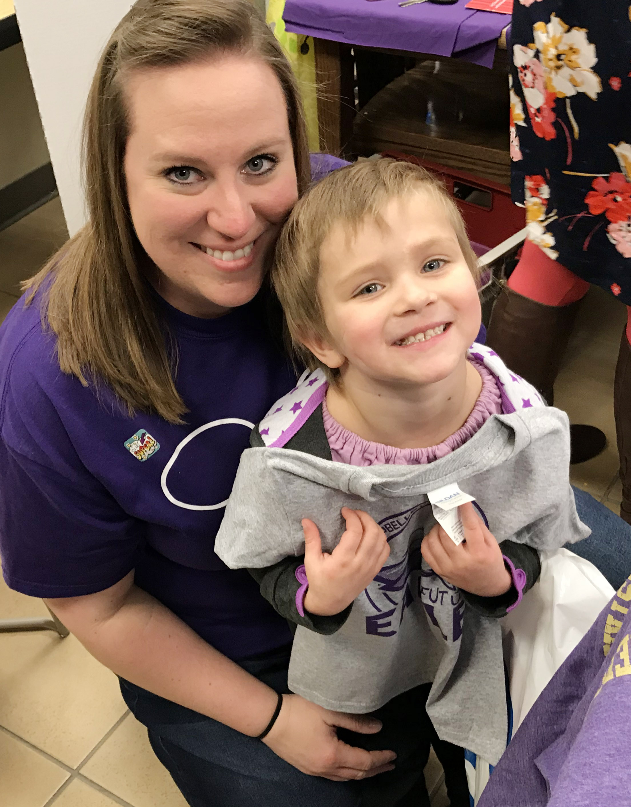 "CES preschool teacher Julie Shelton poses for a photo with her student Elliana Morton as she holds her ""Future Eagle"" t-shirt."