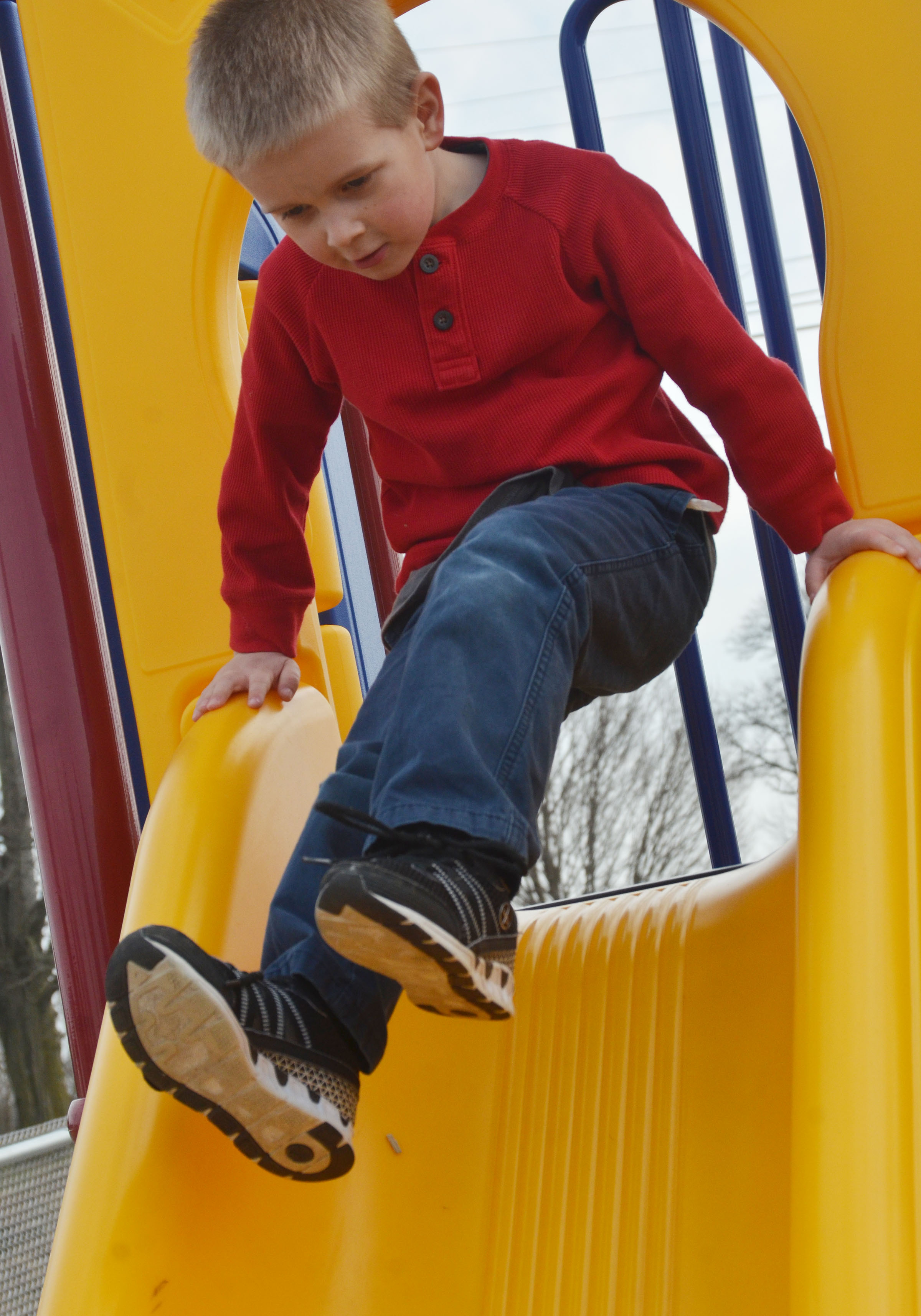 CES preschool student Jacob Parrish slides.