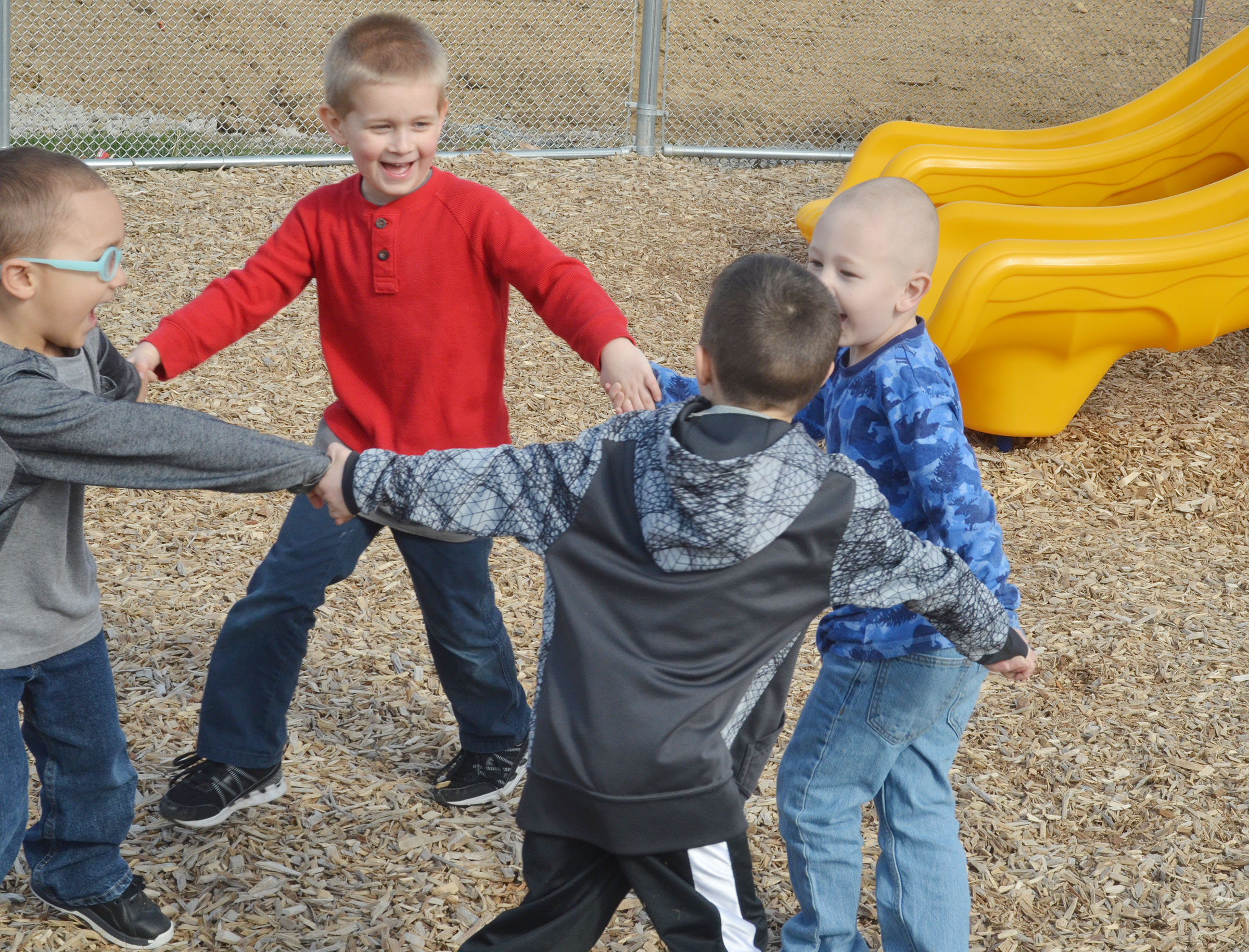 From left, CES preschool students Chanler Mann, Jacob Parrish, Levi Ritchie and Cameron Dean run together.