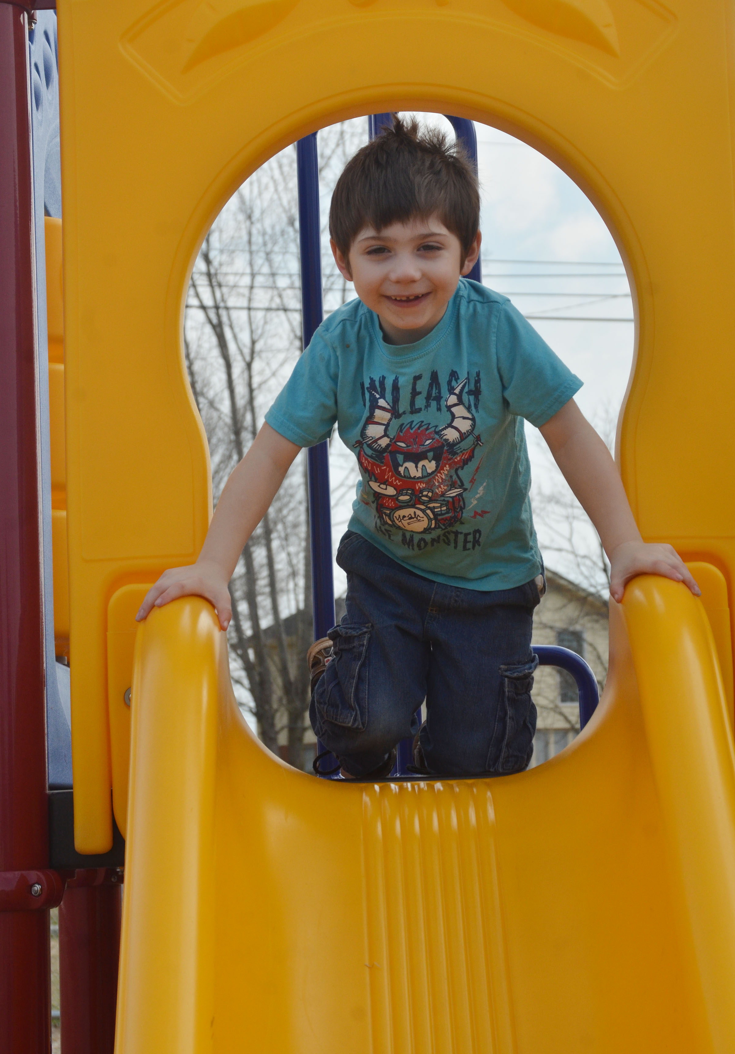 CES preschool student Josiah Dean gets ready to slide.
