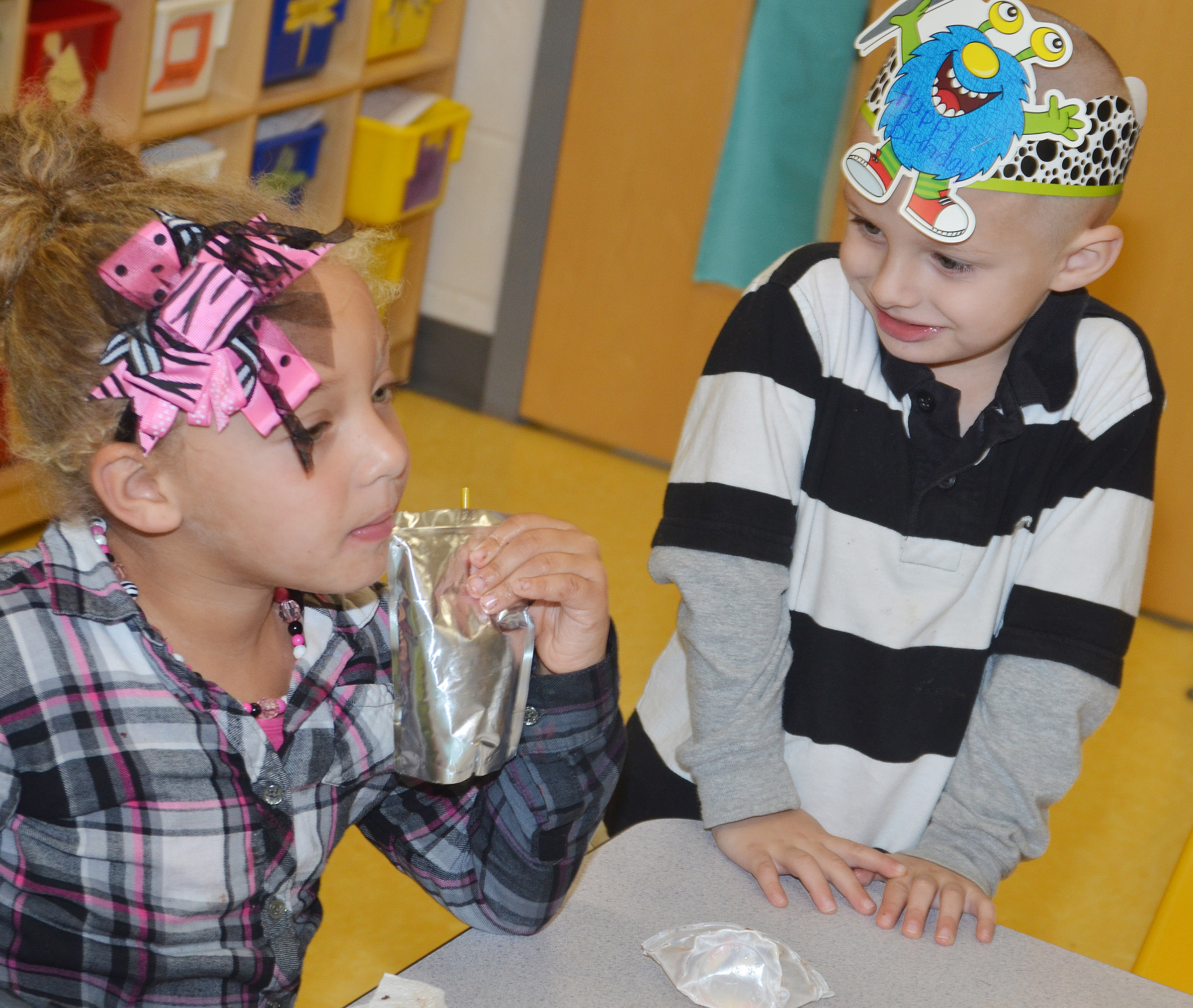 CES preschool student Nevon Stum celebrates his birthday with classmate Jayla Barbee.