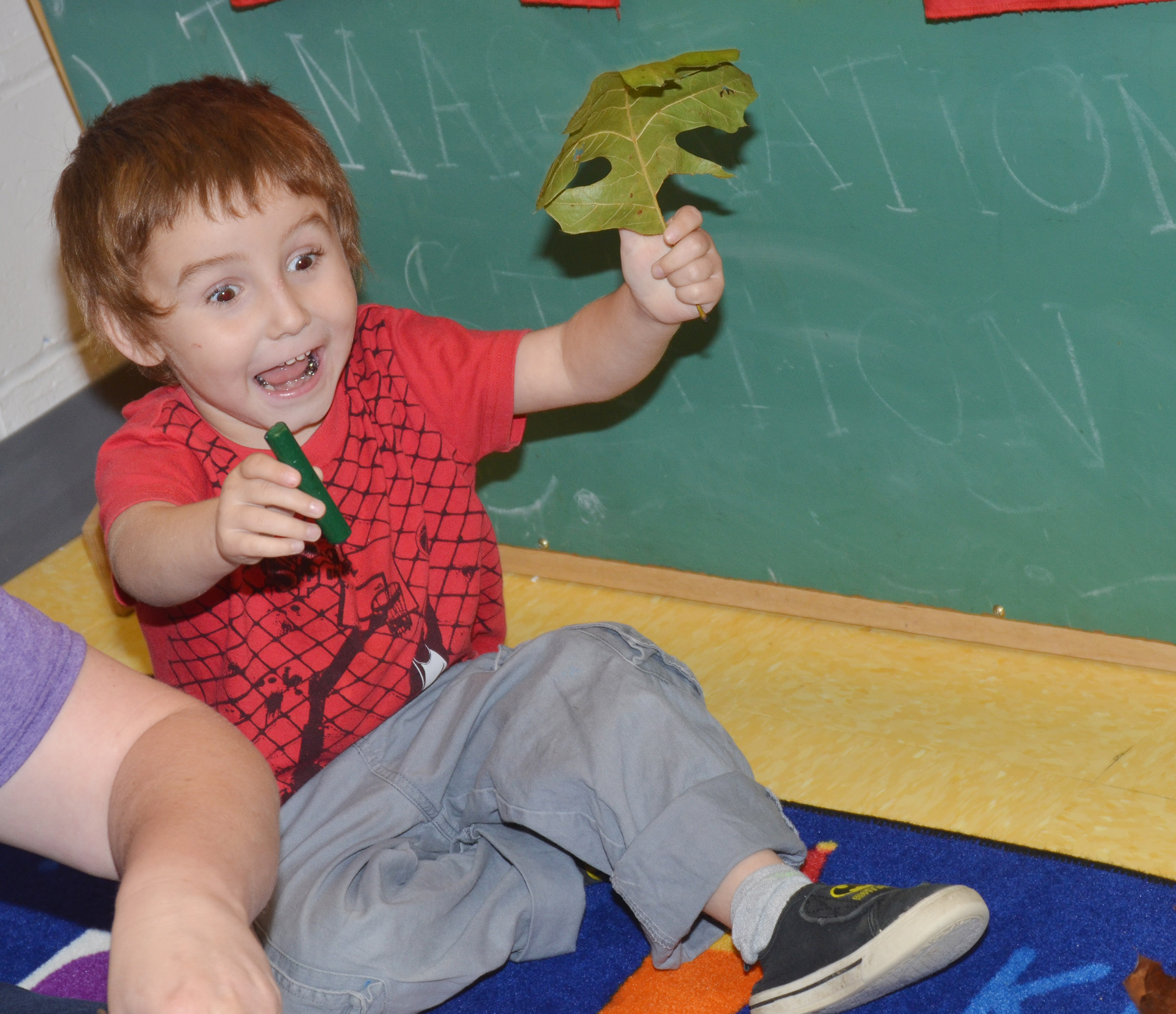 CES preschool student Noelan McMahan says he found a green leaf.