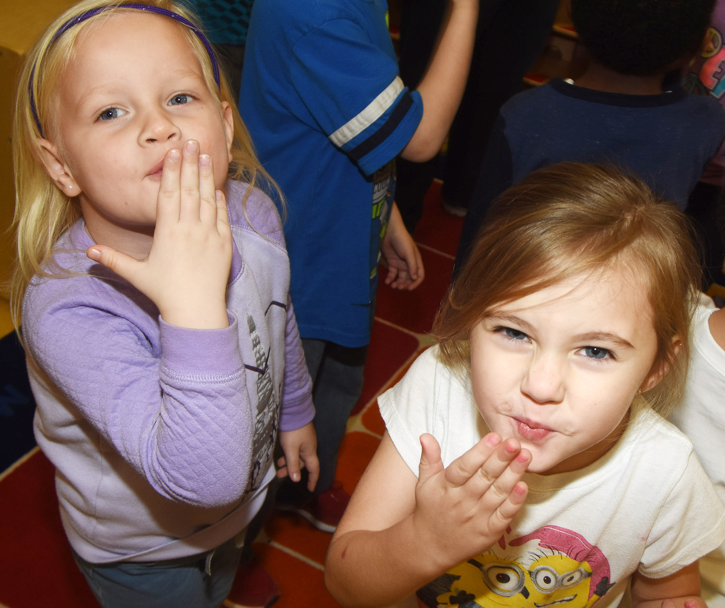 CES preschool students Kaitlyn Marples, at left, and Jackson Grigsby blow kisses as they sing and dance together.