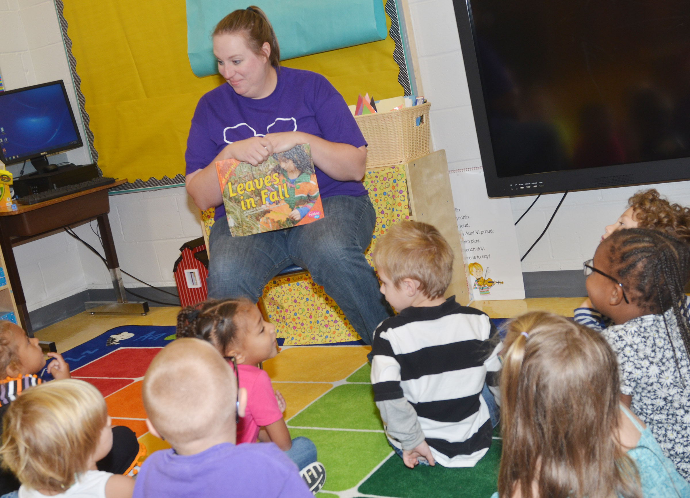 CES preschool teacher Julie Shelton talks to her students about the fall season.
