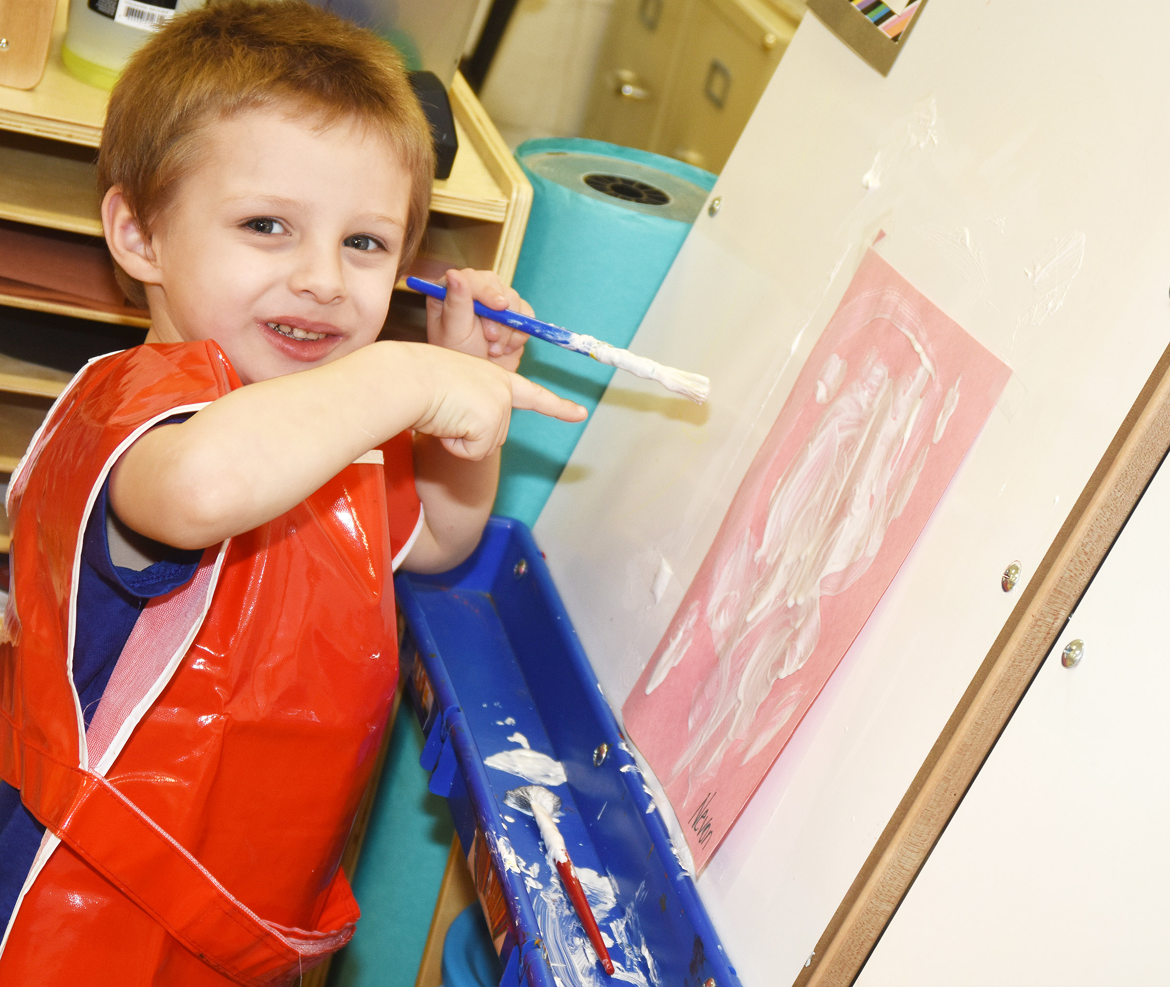 CES preschool student Nevon Stum shows off his painting.