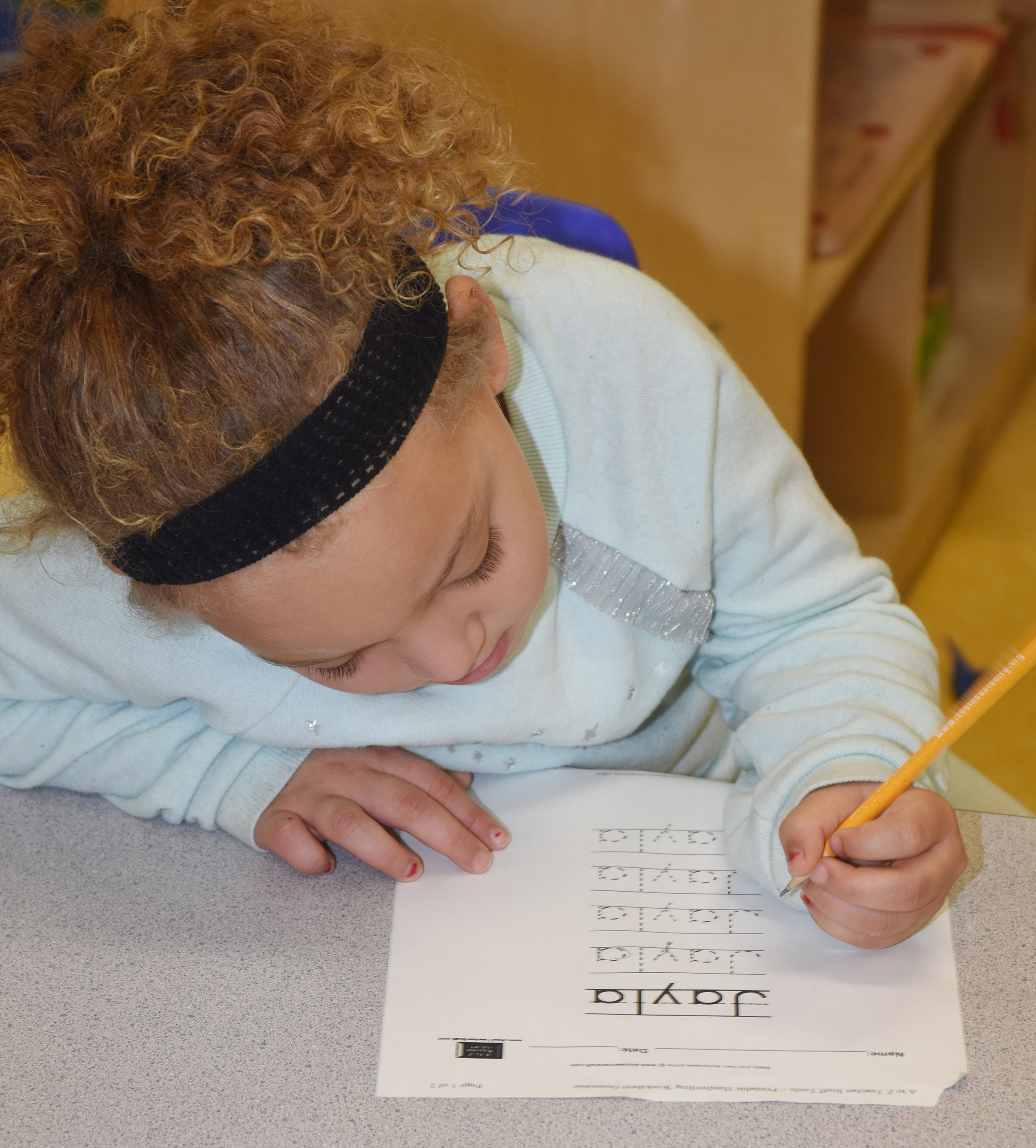 CES preschool student Jayla Barbee writes her name.