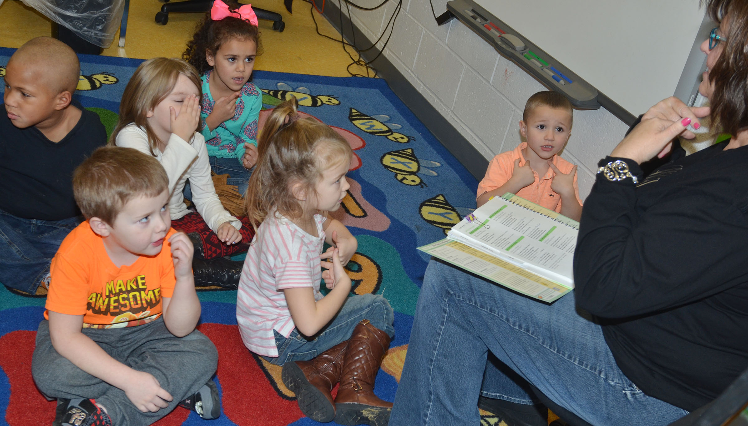Susan Kennon, a Campbellsville Family Resource and Youth Services Center liaison at CES, sings a song about feelings with preschool students.