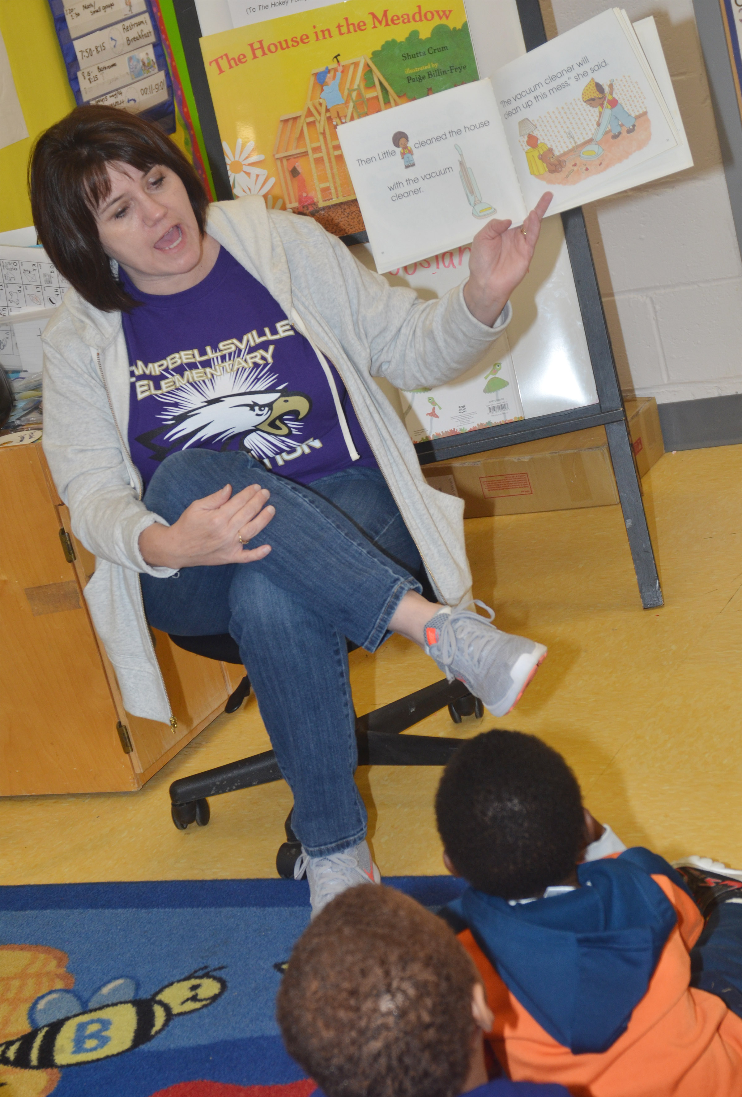 CES preschool teacher Denise Spencer reads a book about the letter V.