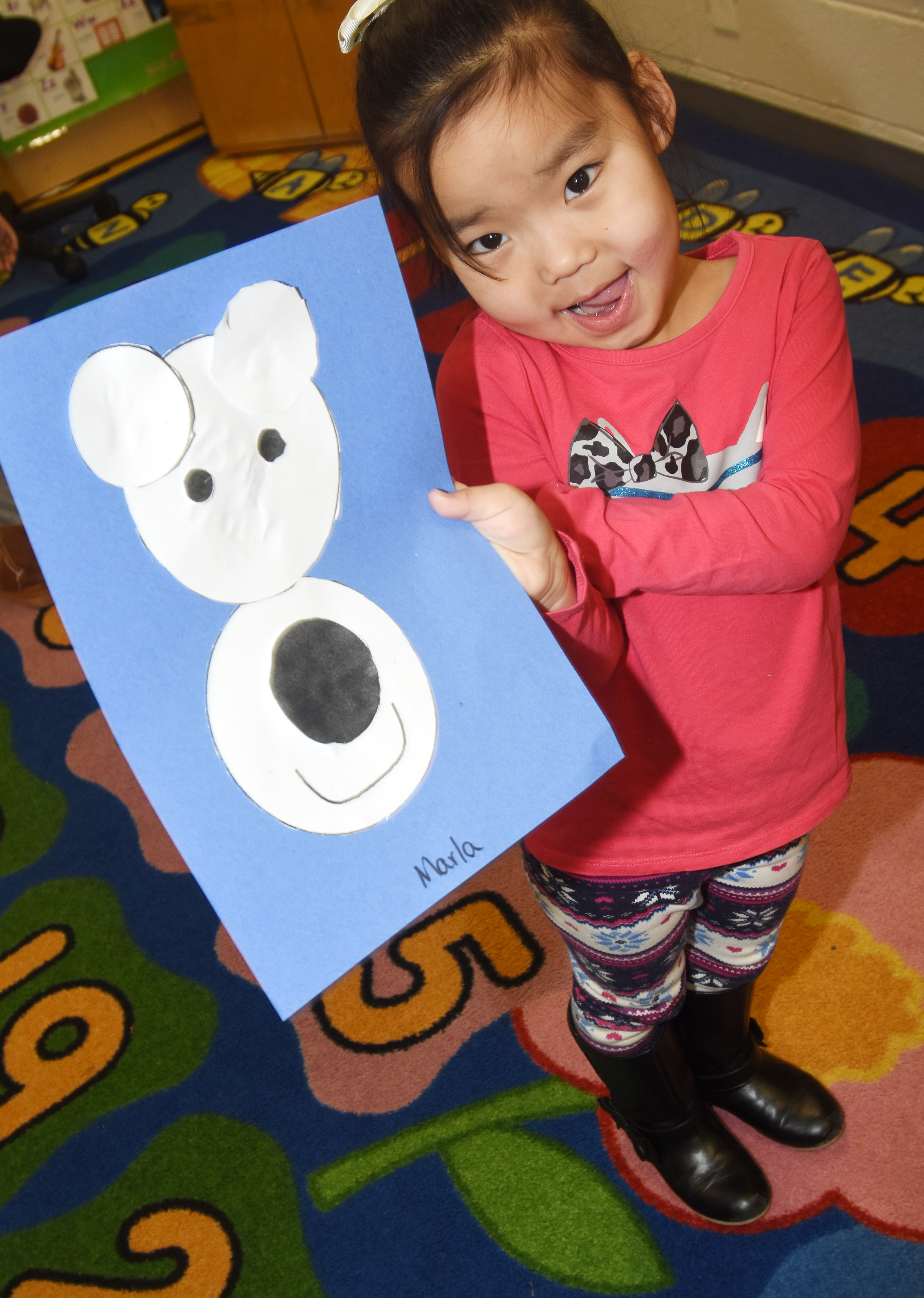 CES preschool student Marla Bat holds her polar bear.