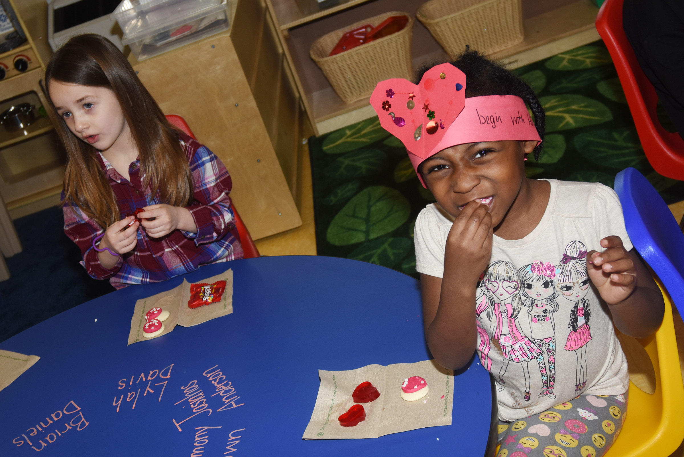 CES preschool students Lylah Davis, at left, and Harmony Brown enjoy Valentine snacks.