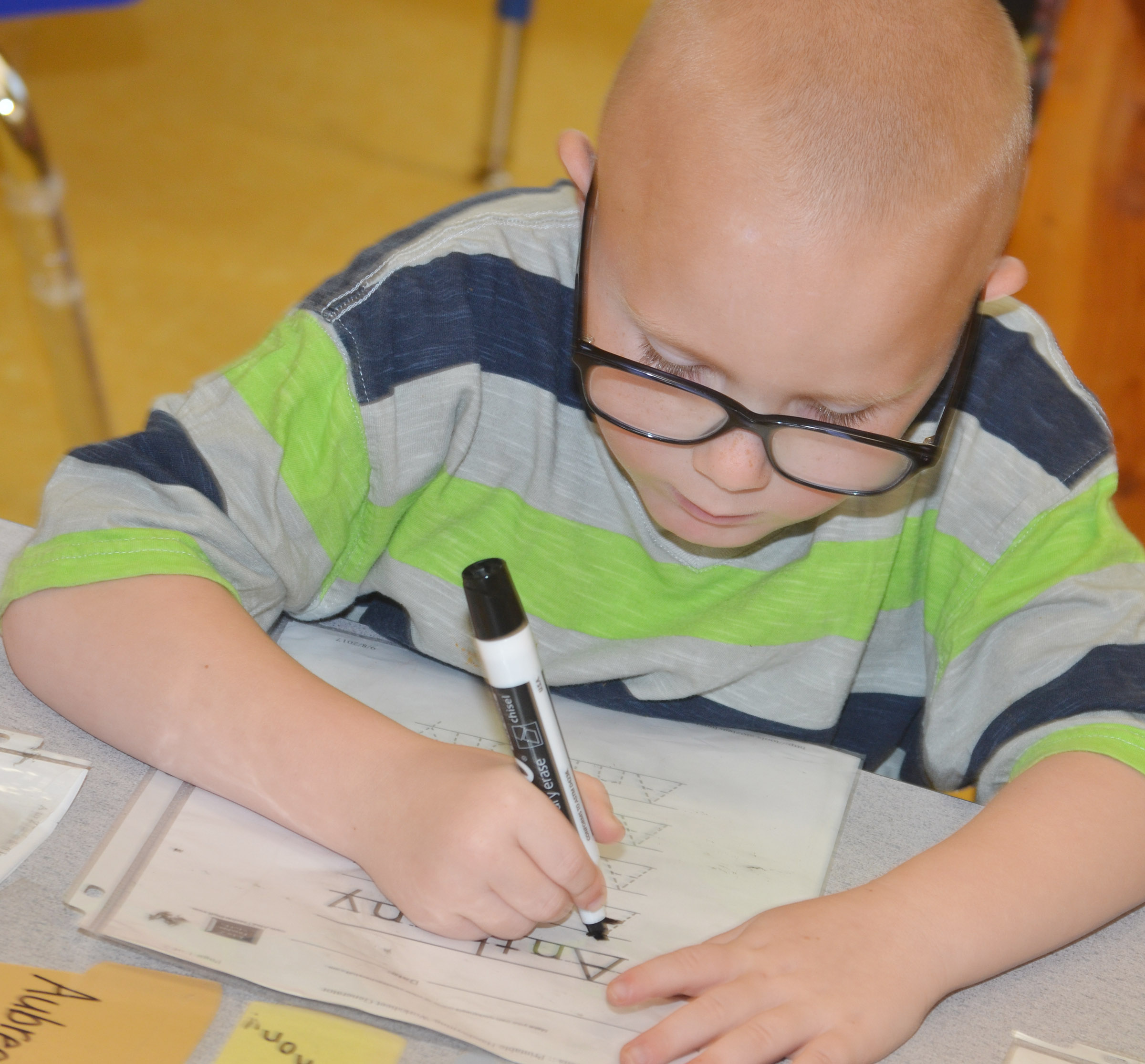 CES preschool student Anthony McClure practices writing his name.