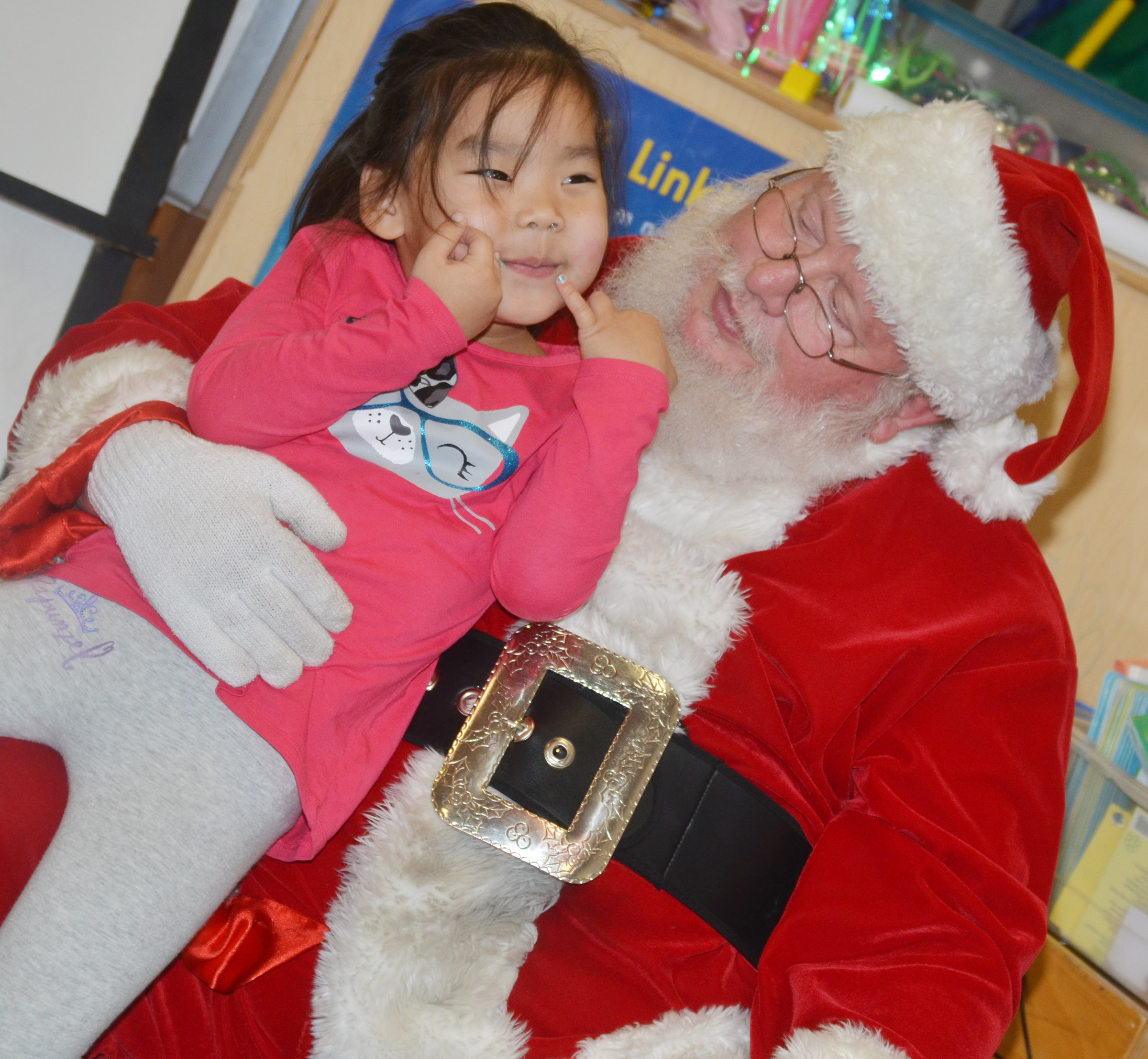 CES preschool student Marla Bat talks to Santa.