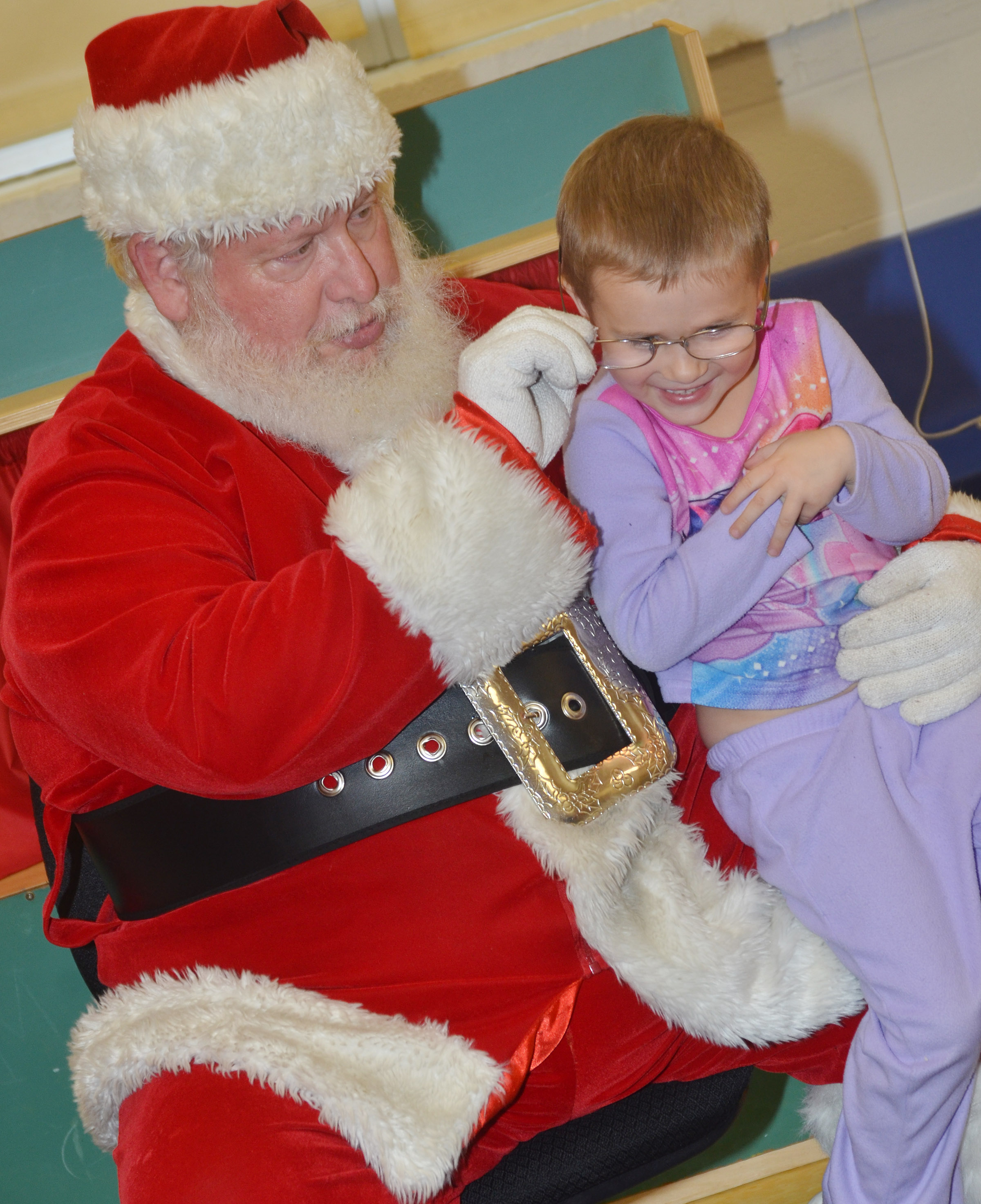 CES preschool student Elliana Morton tries on Santa's glasses.