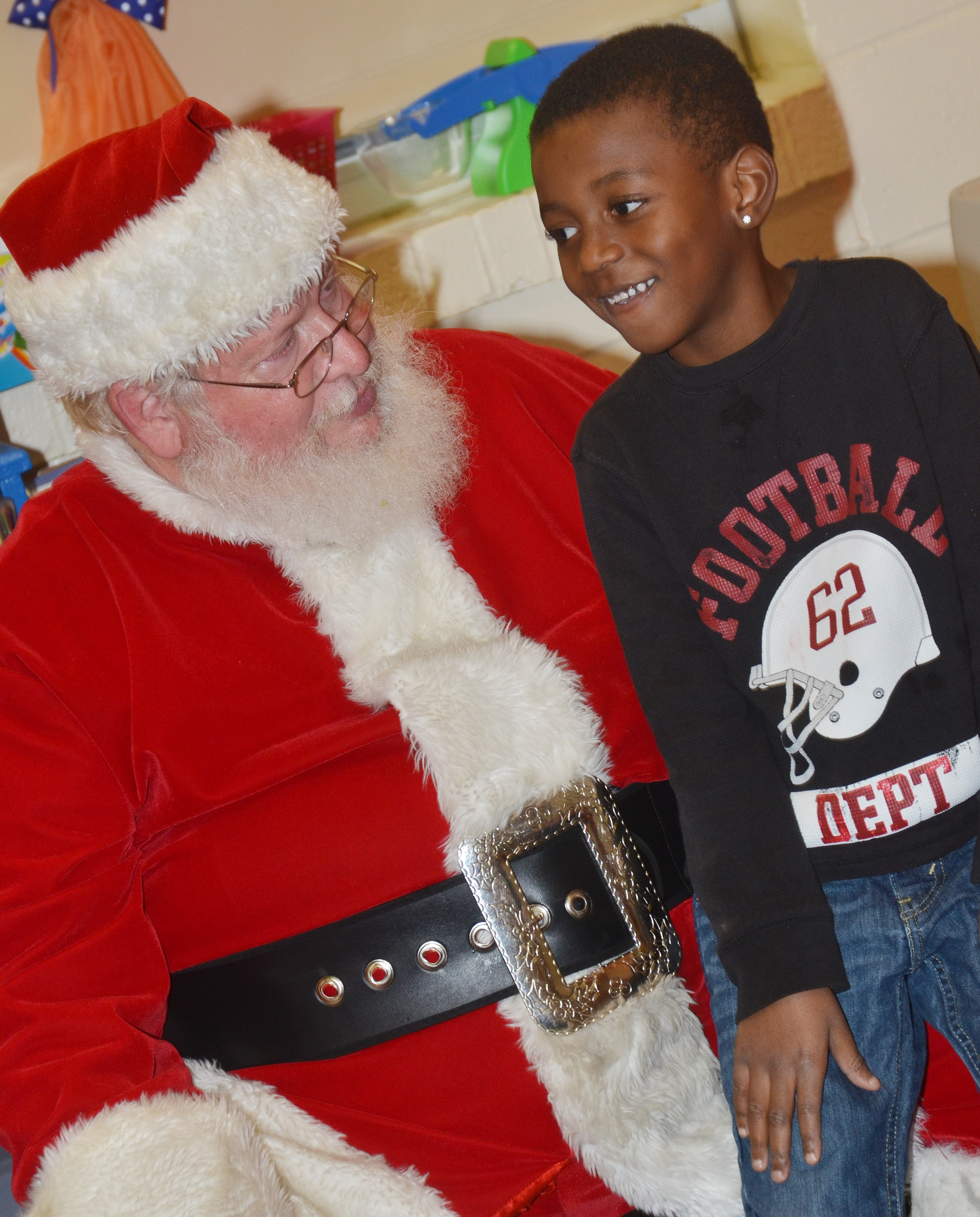 CES kindergartener Zyhaven Taylor talks to Santa.