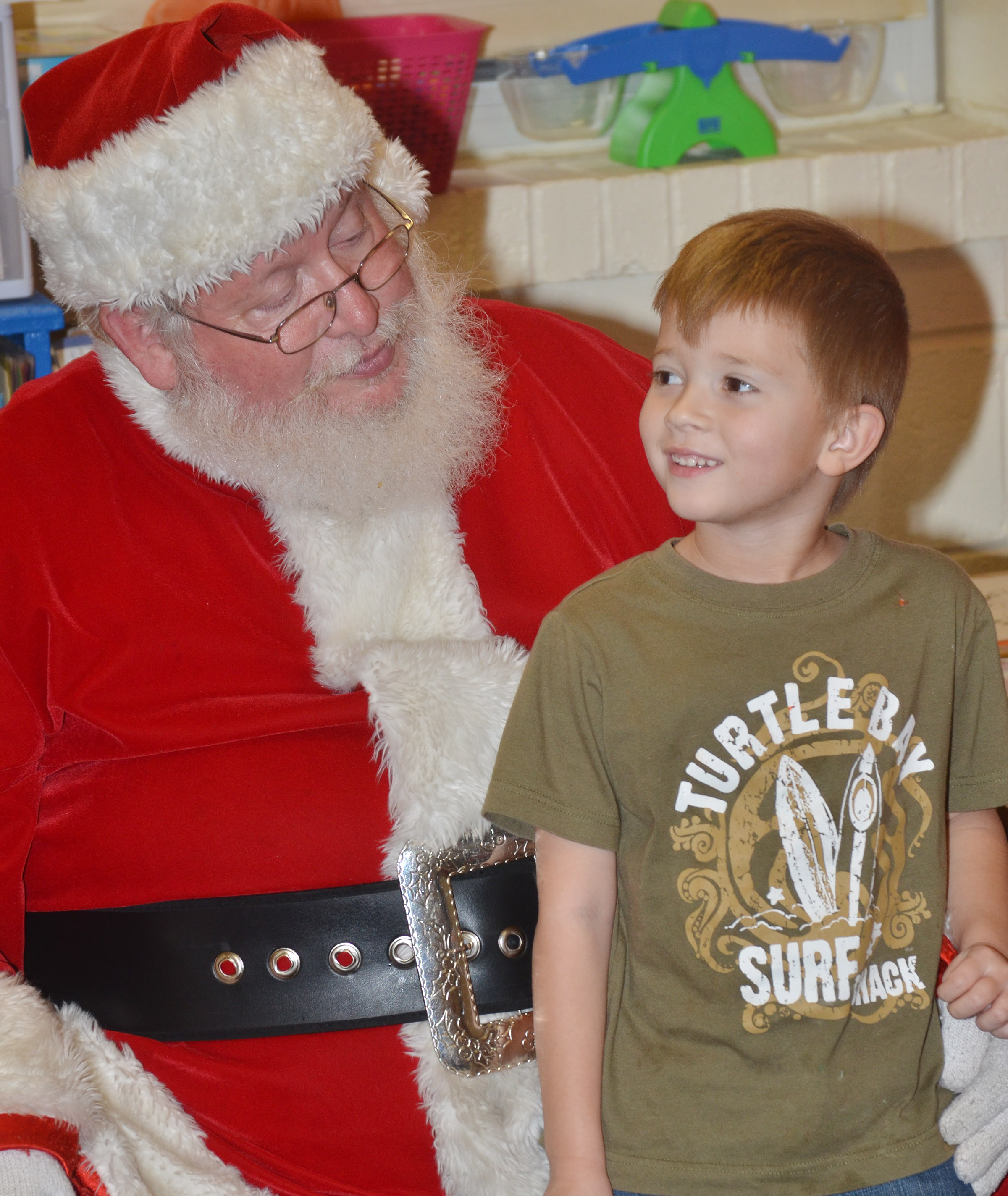 CES kindergartener Andrew Stout talks to Santa.